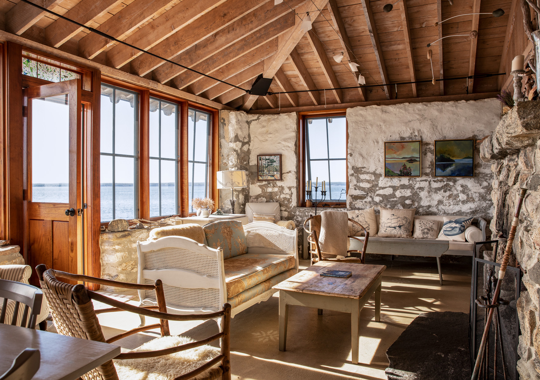 rustic main house living room with stone walls
