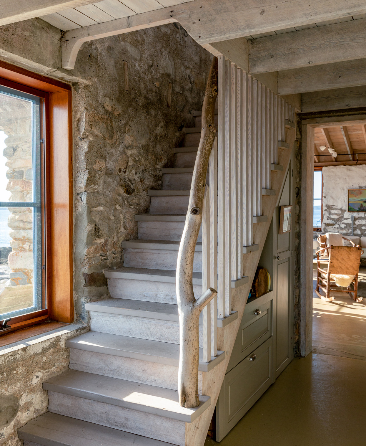 rustic main house staircase with driftwood banister