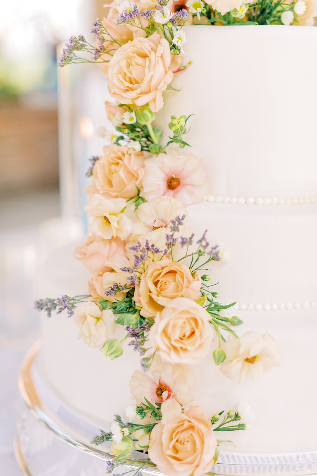 floral lined three tiered wedding cake
