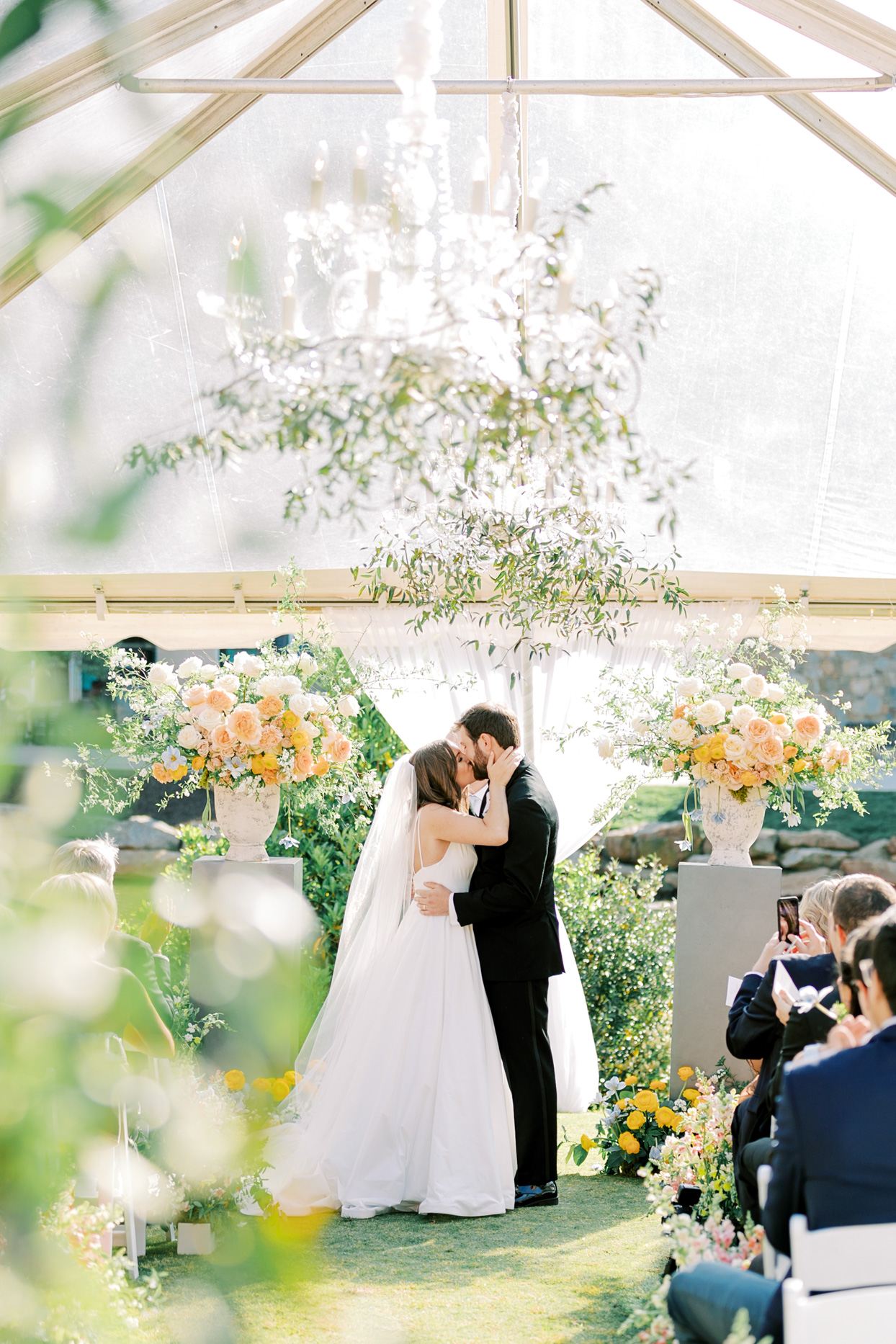 bride and groom sharing a kiss after wedding ceremony