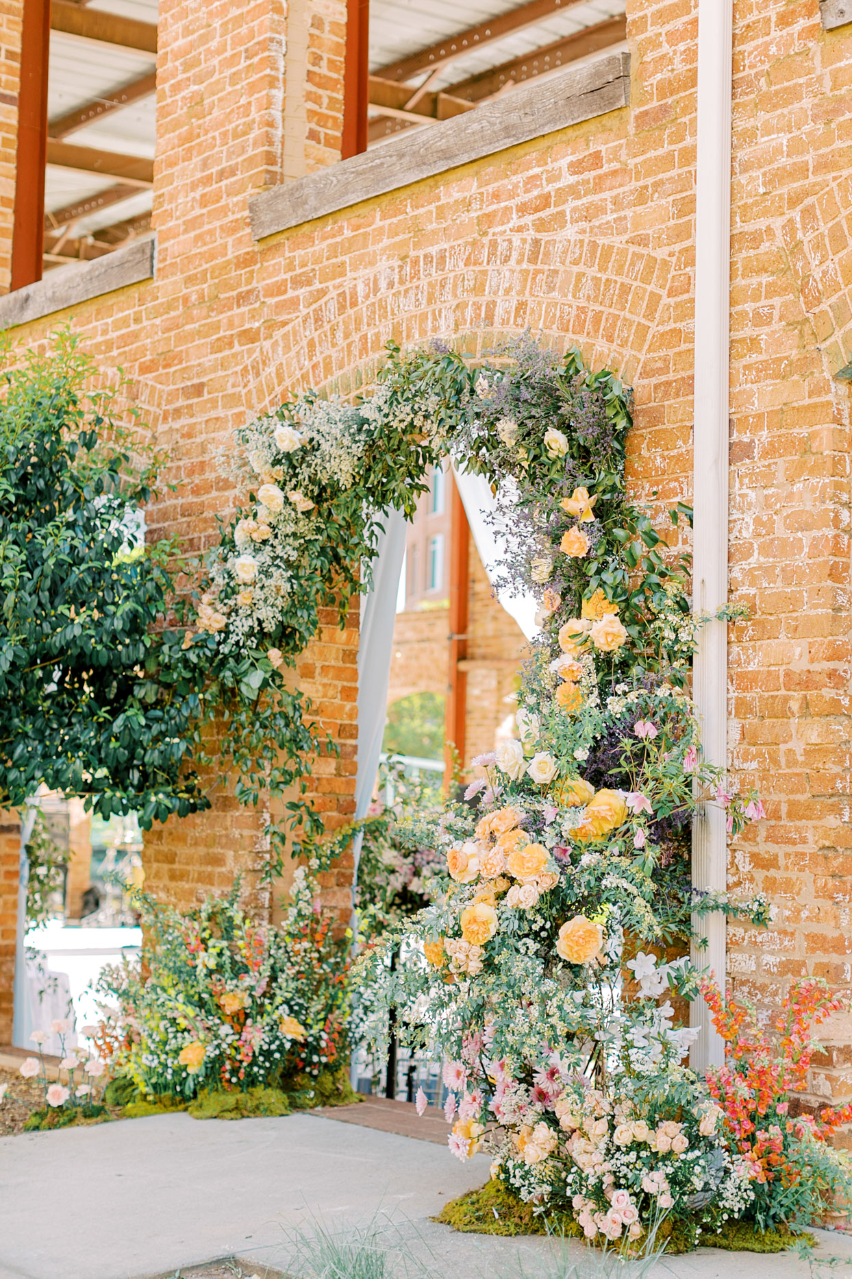 floral covered archway wedding entrance