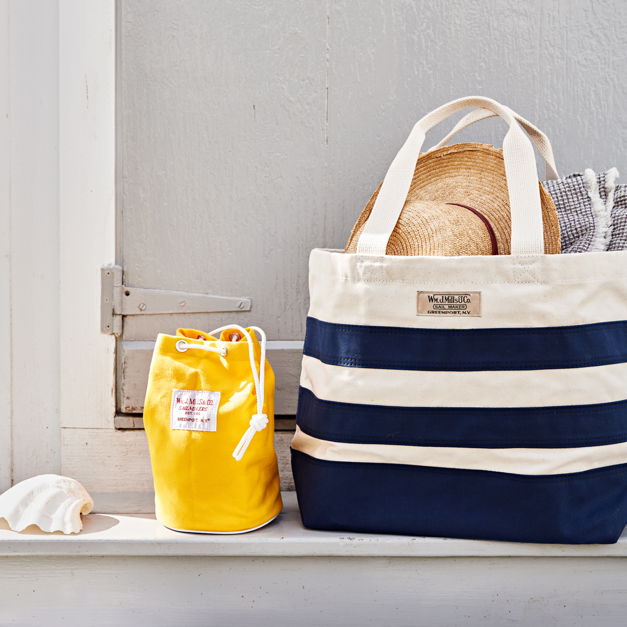striped pool bag with sun hat