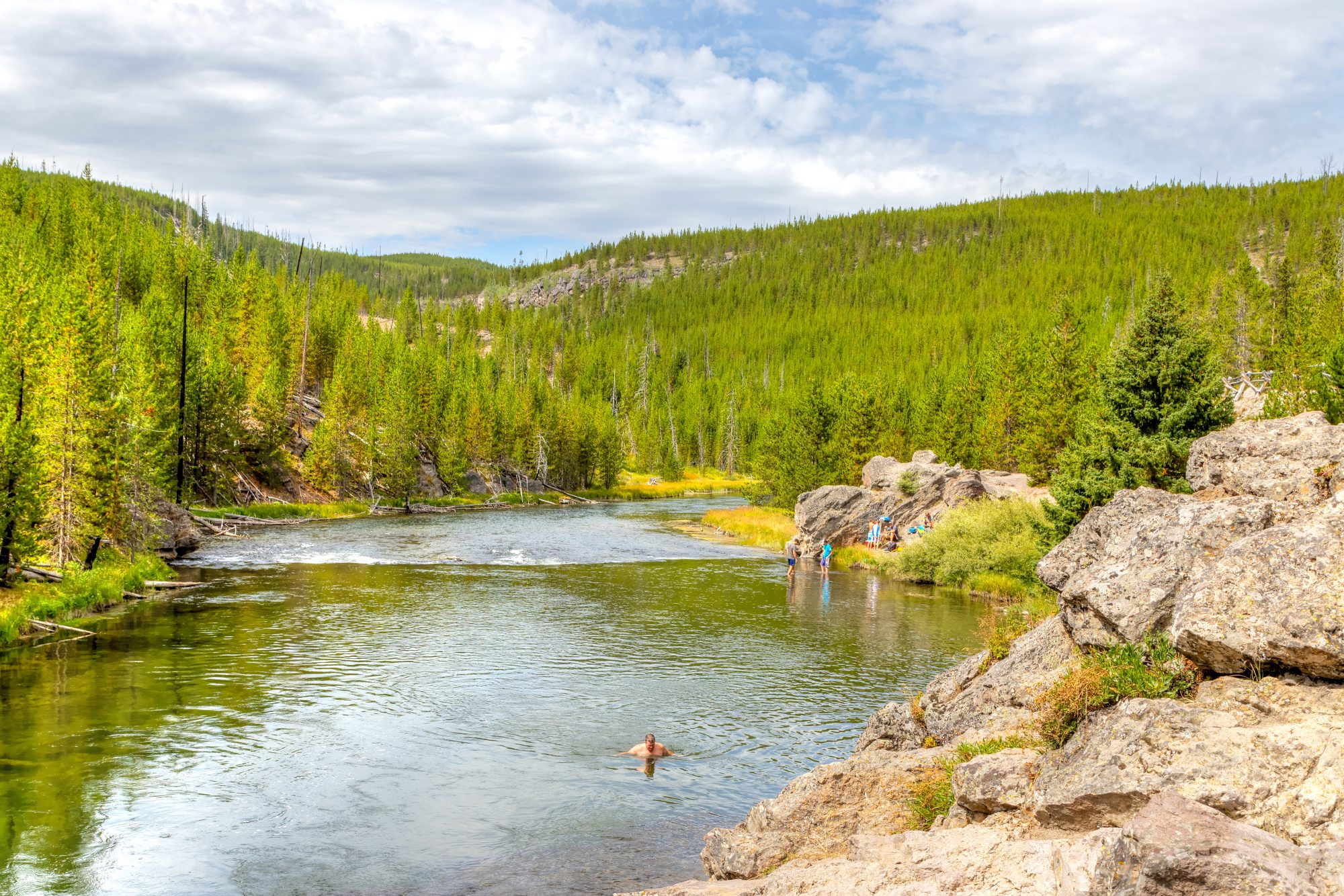 Swimming in Firehole River in Yellowstone National Park