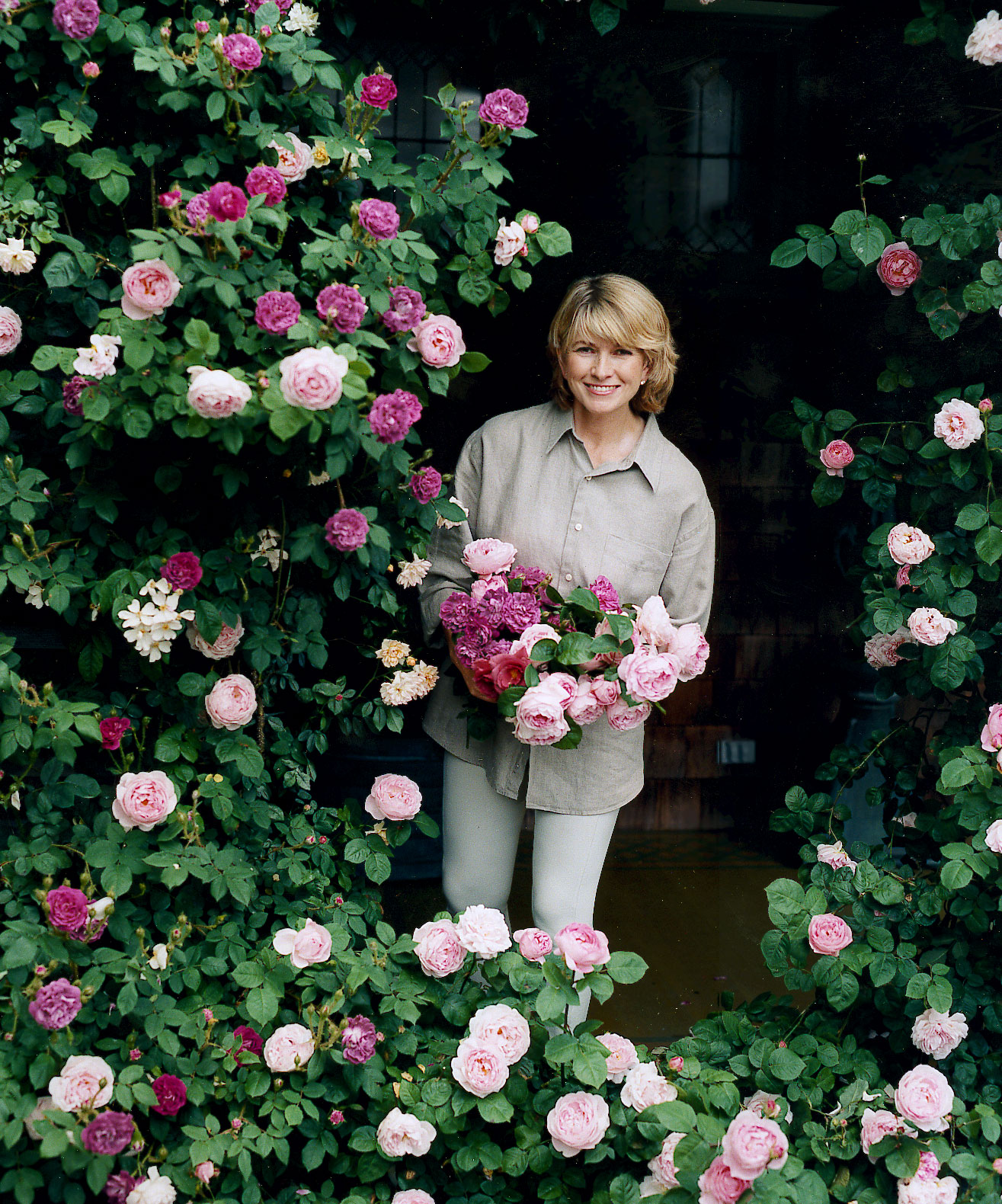 martha with roses in garden