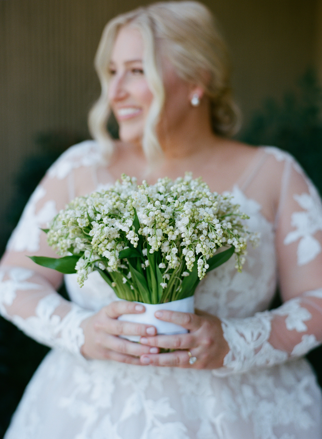 Bride holding bouquet with white flowers