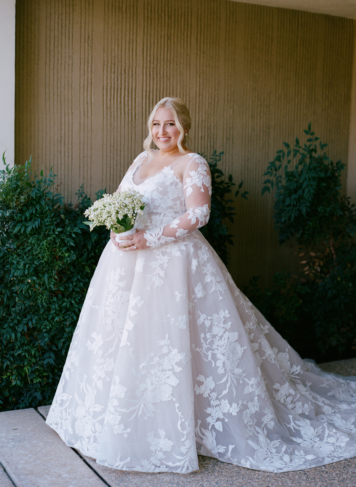 bride in a-line wedding dress with lace floral overlay
