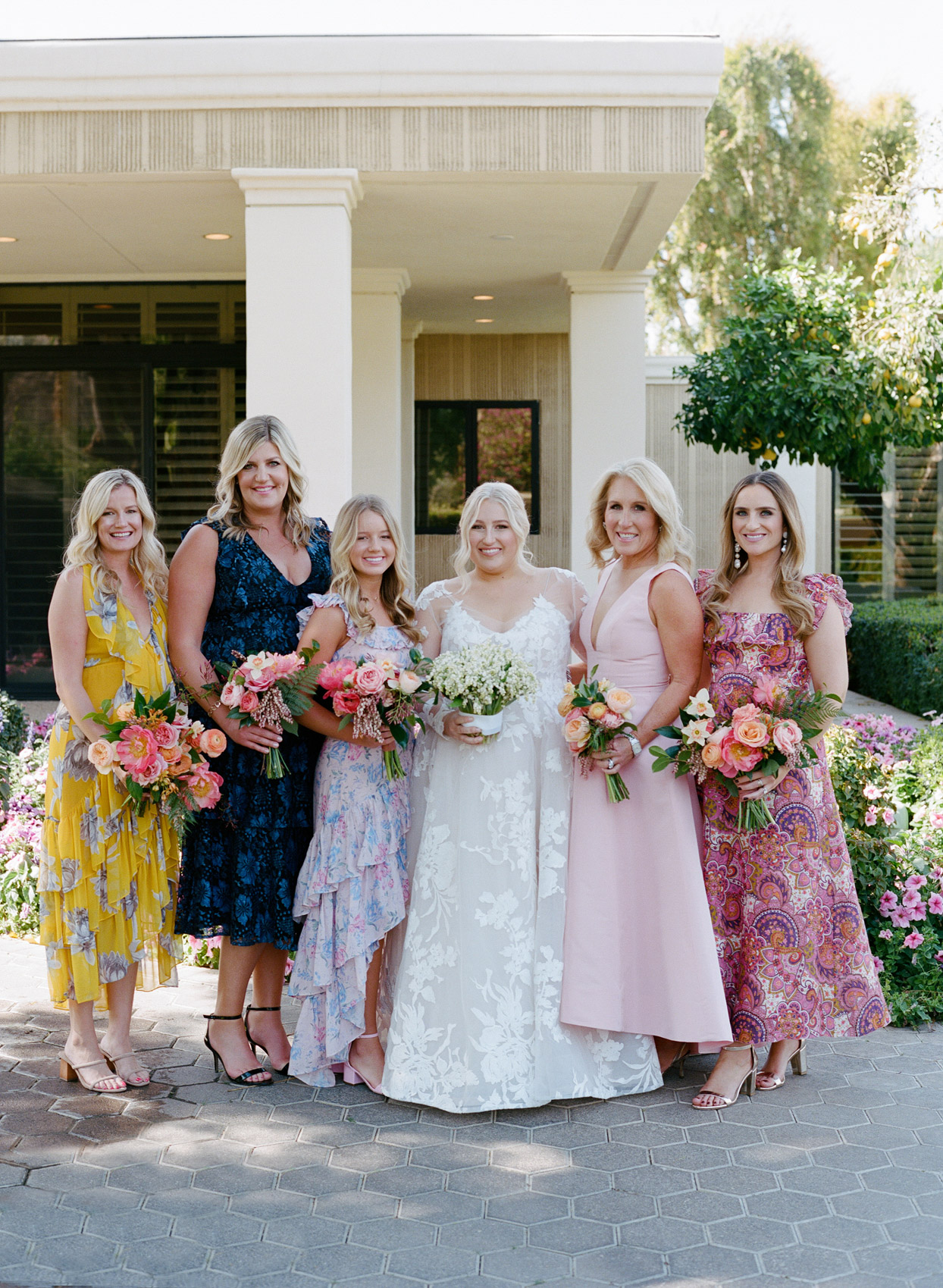 bride with five bridesmaids in mismatched colorful dresses