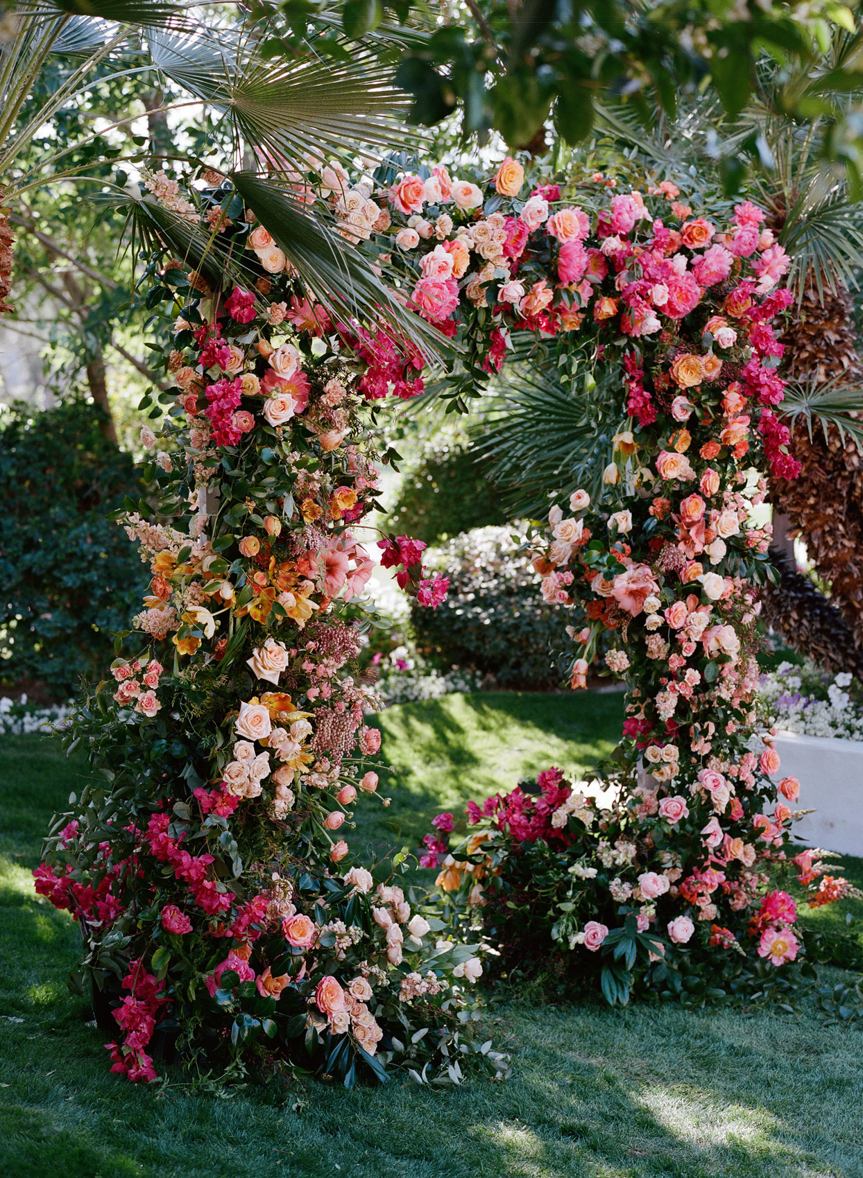 pink and orange floral arch