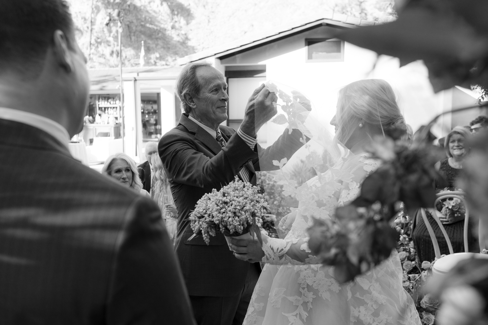 bride being unveiled by father