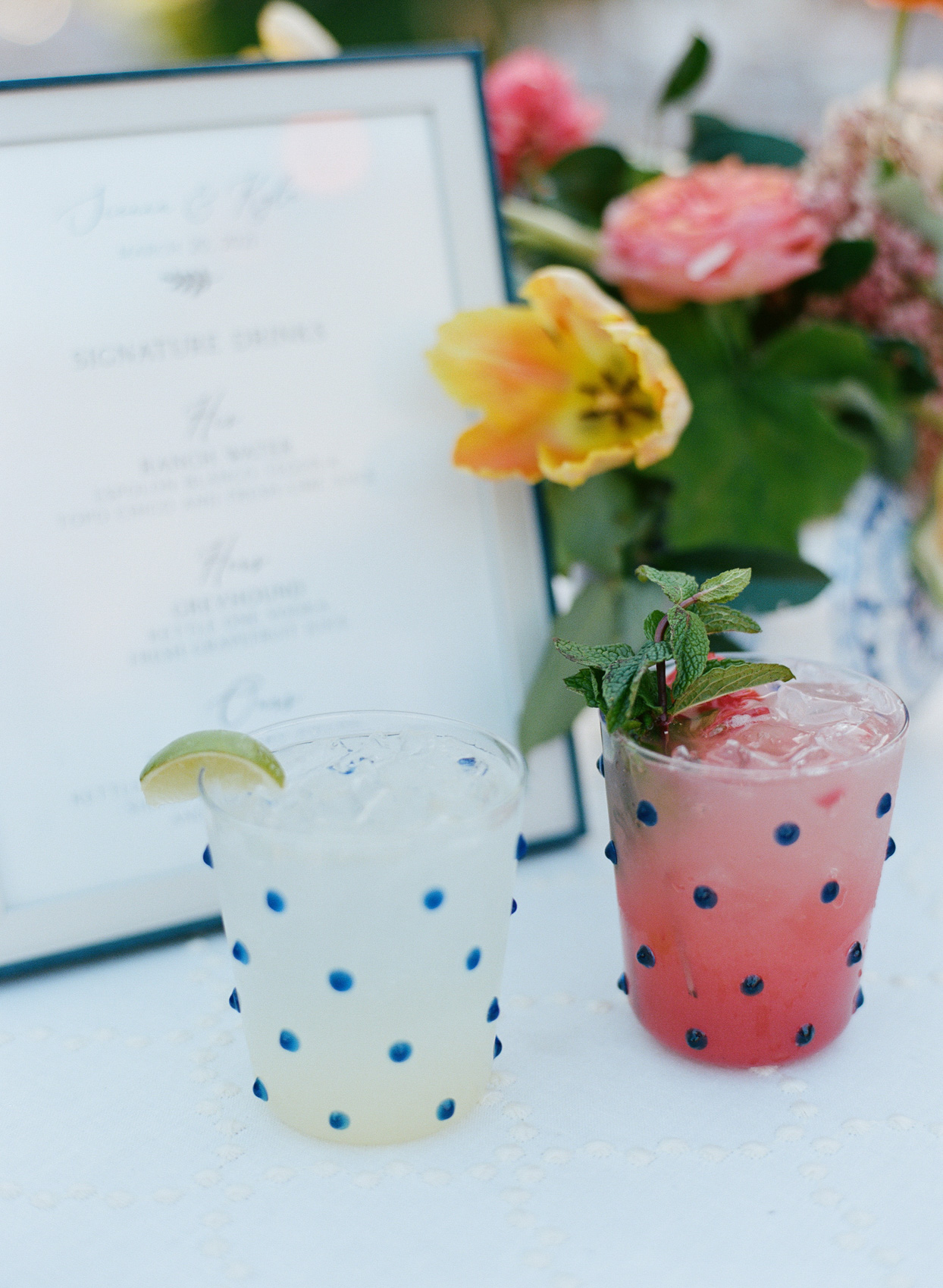 blue spotted cocktail glasses filled with specialty cocktails