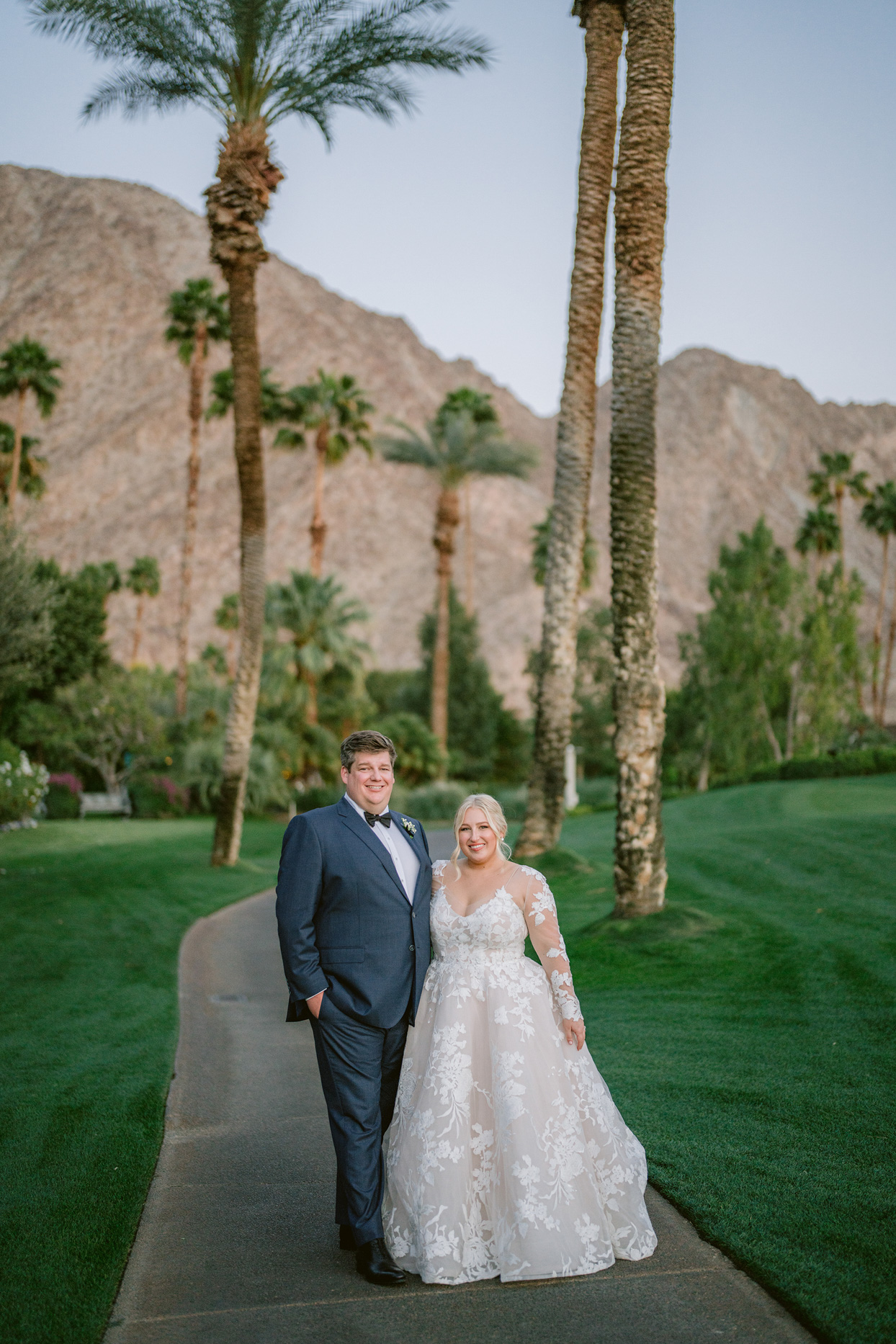 bride and groom by palm trees