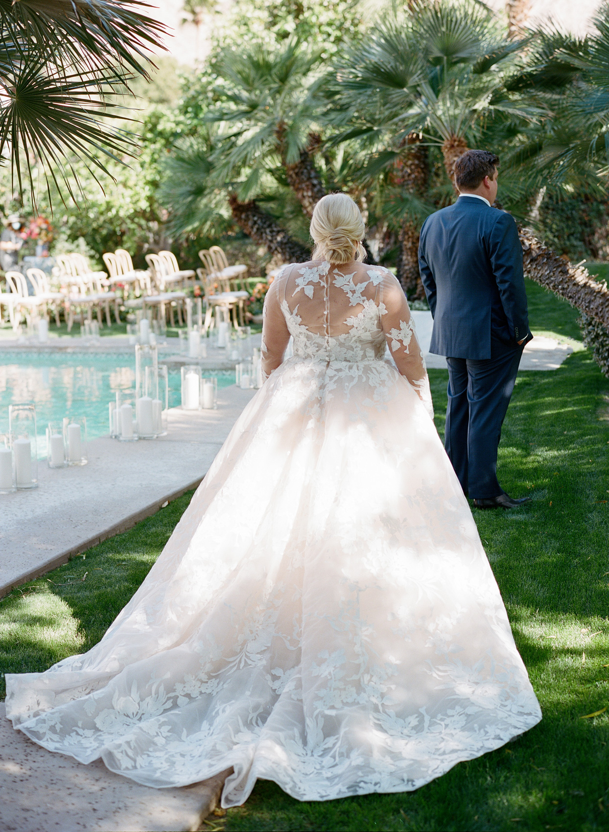 bride and groom first look by pool