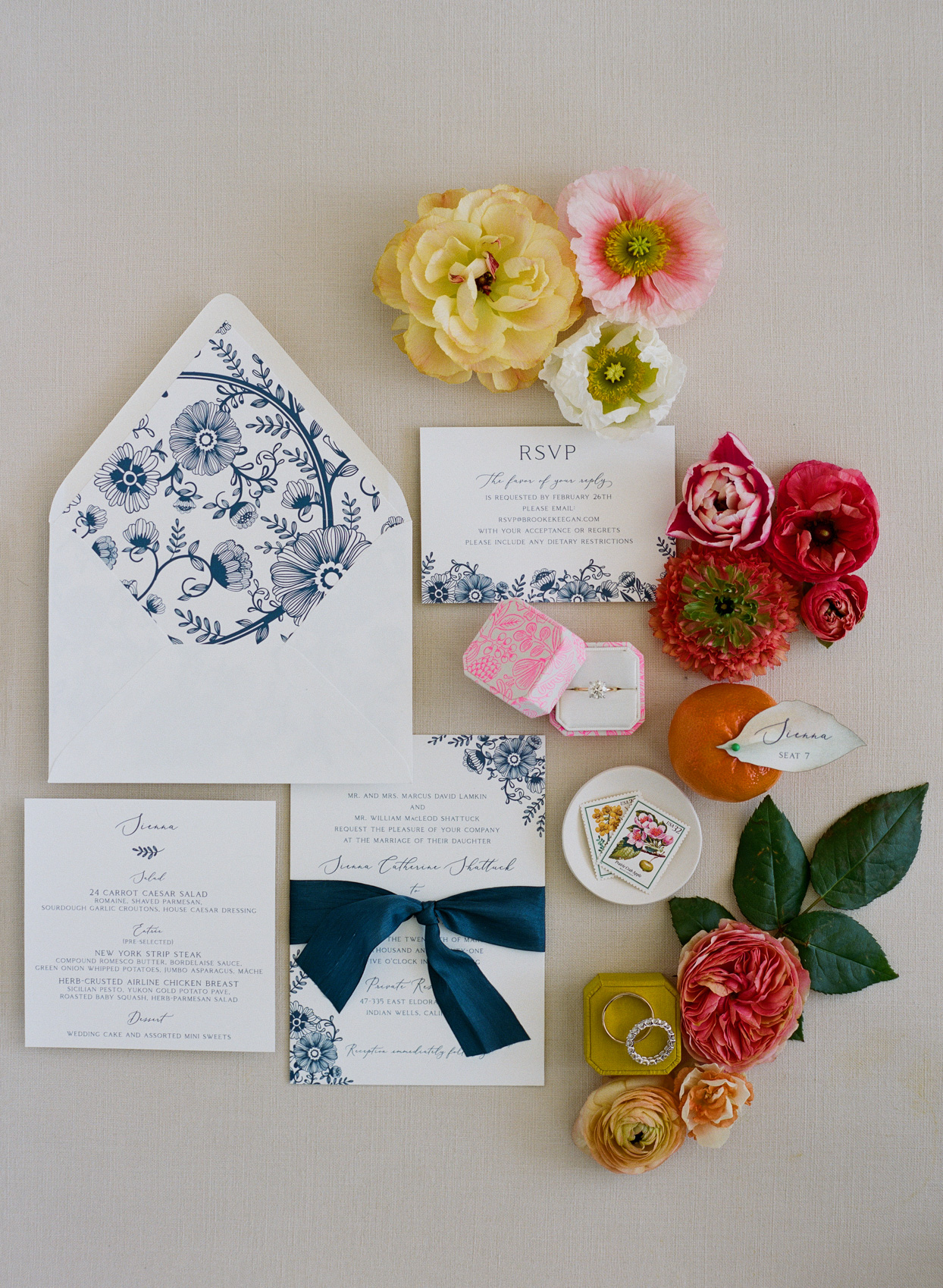 wedding invitation suite with navy and warm accents