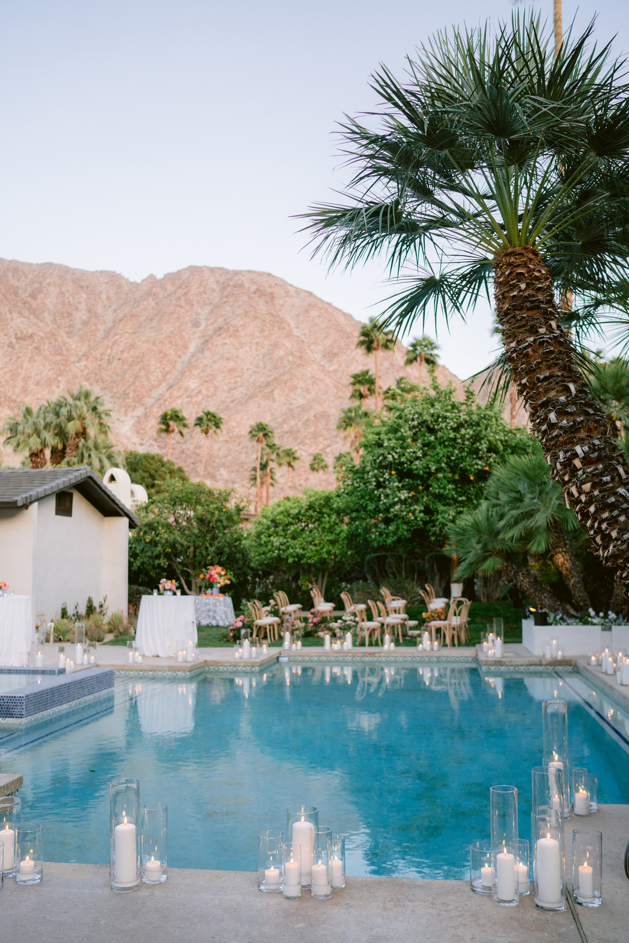wedding venue pool set with candles and mountain landscape