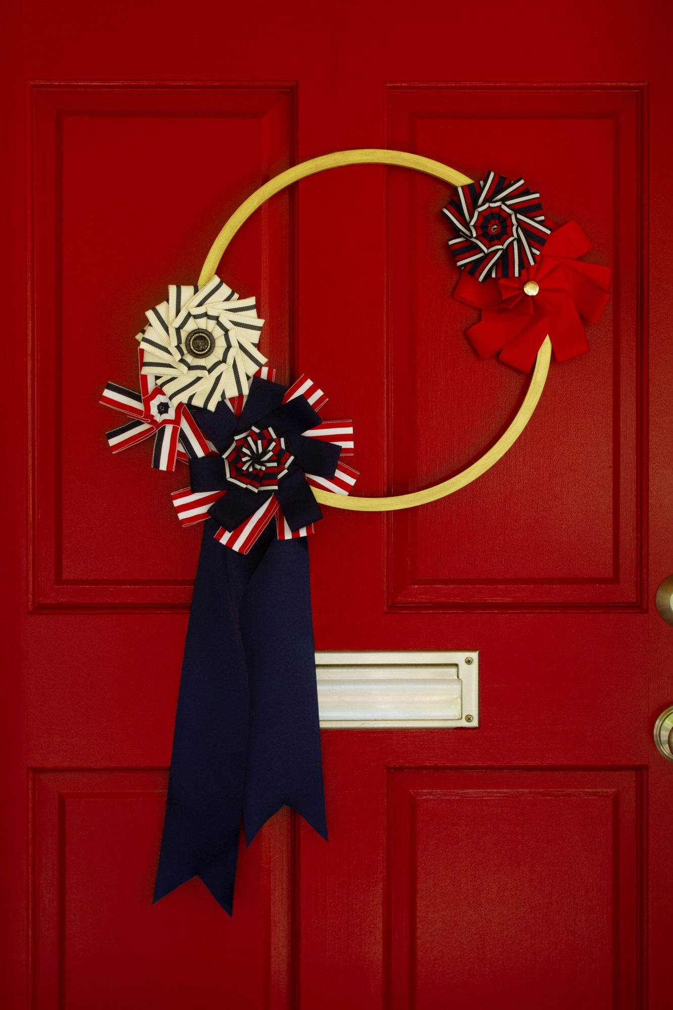 patriotic fourth of july wreath on red door