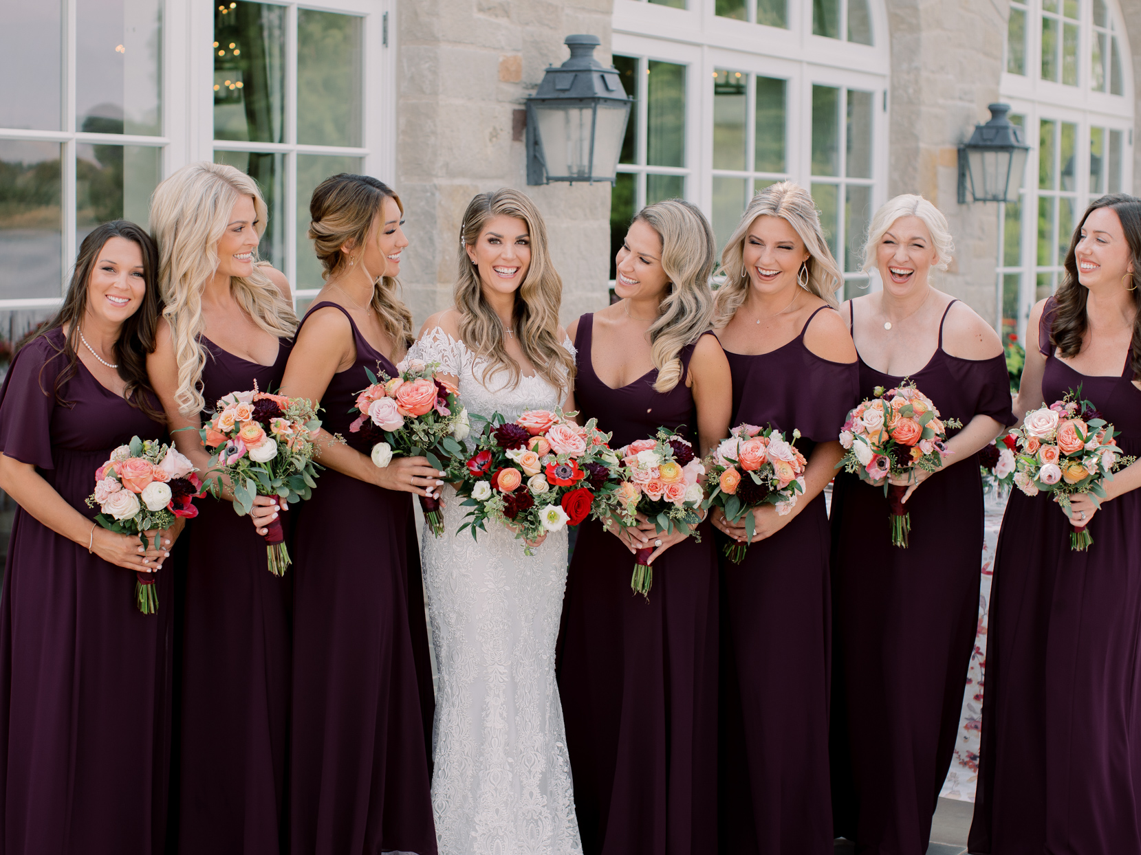 bride with bridesmaids in purple floor-length gowns