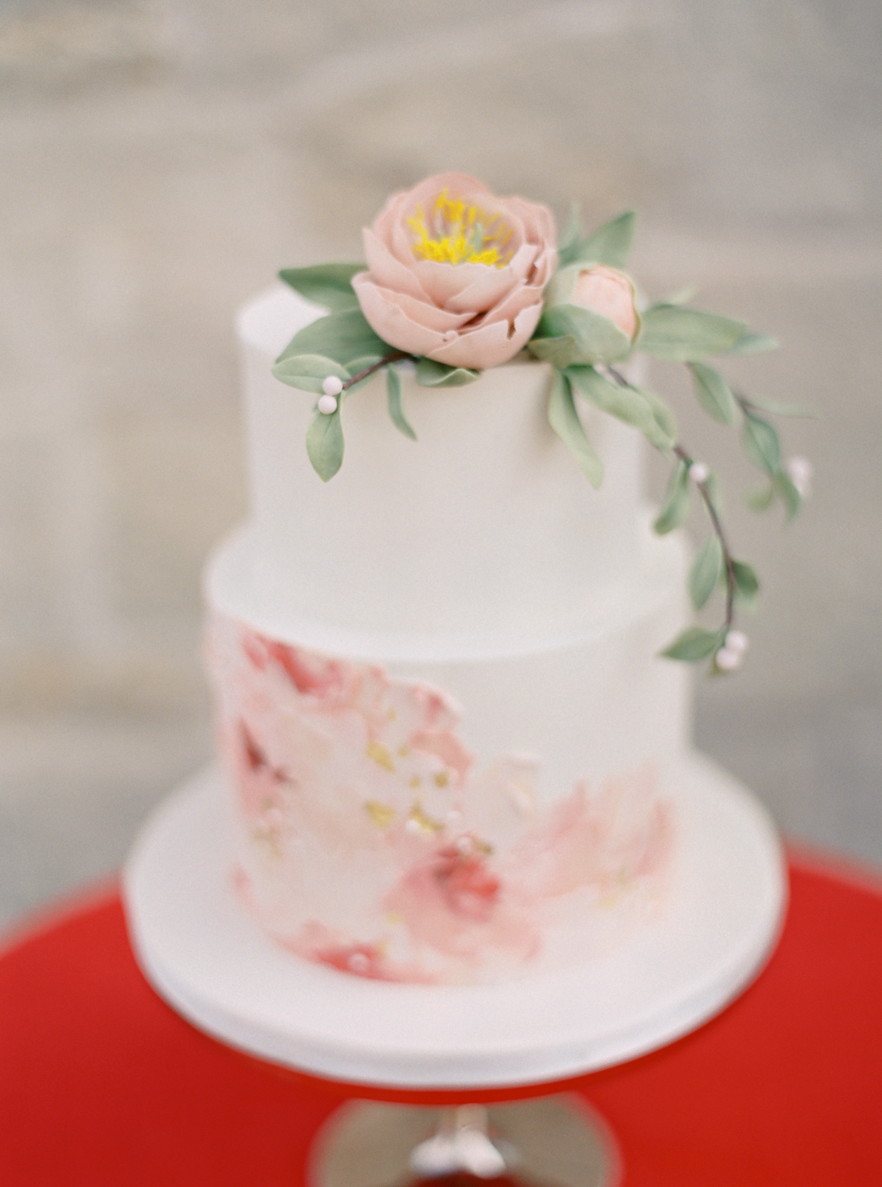 white wedding cake with floral elements