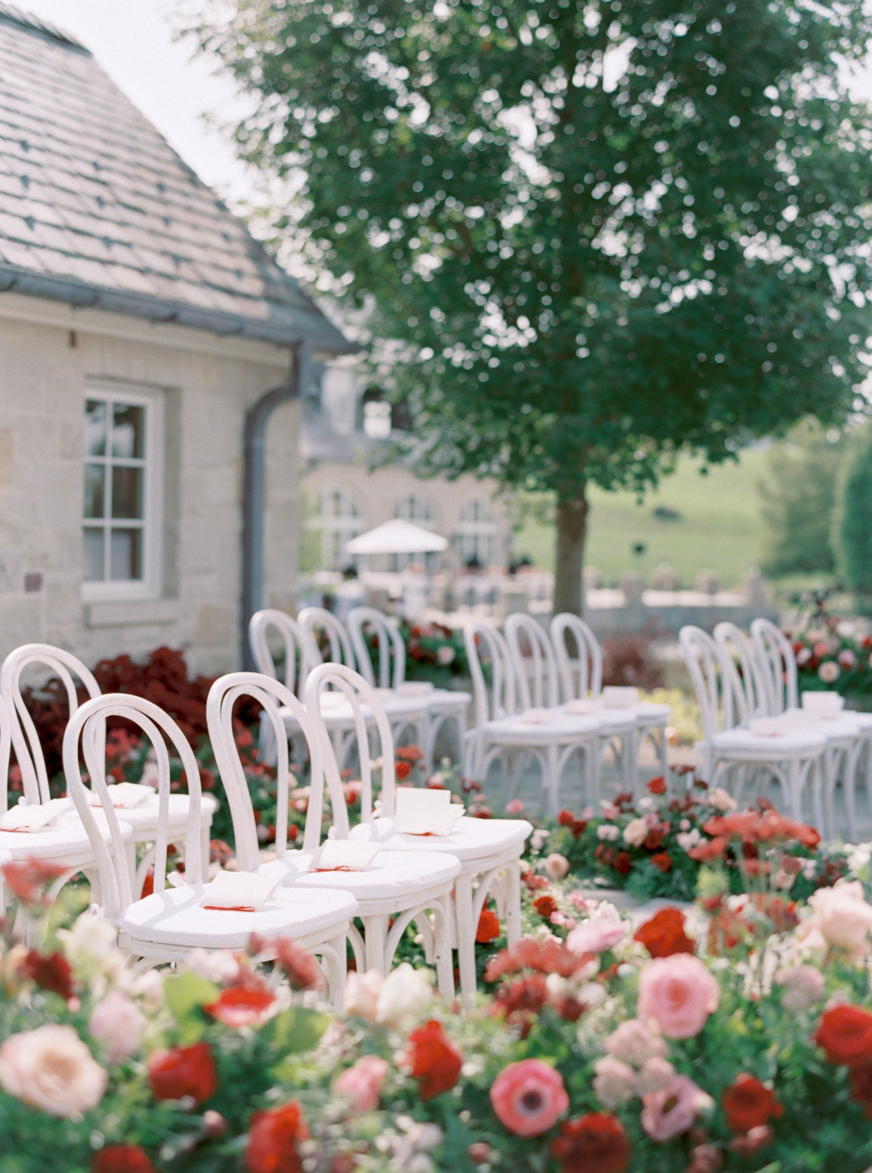 white chairs for outdoor wedding ceremony