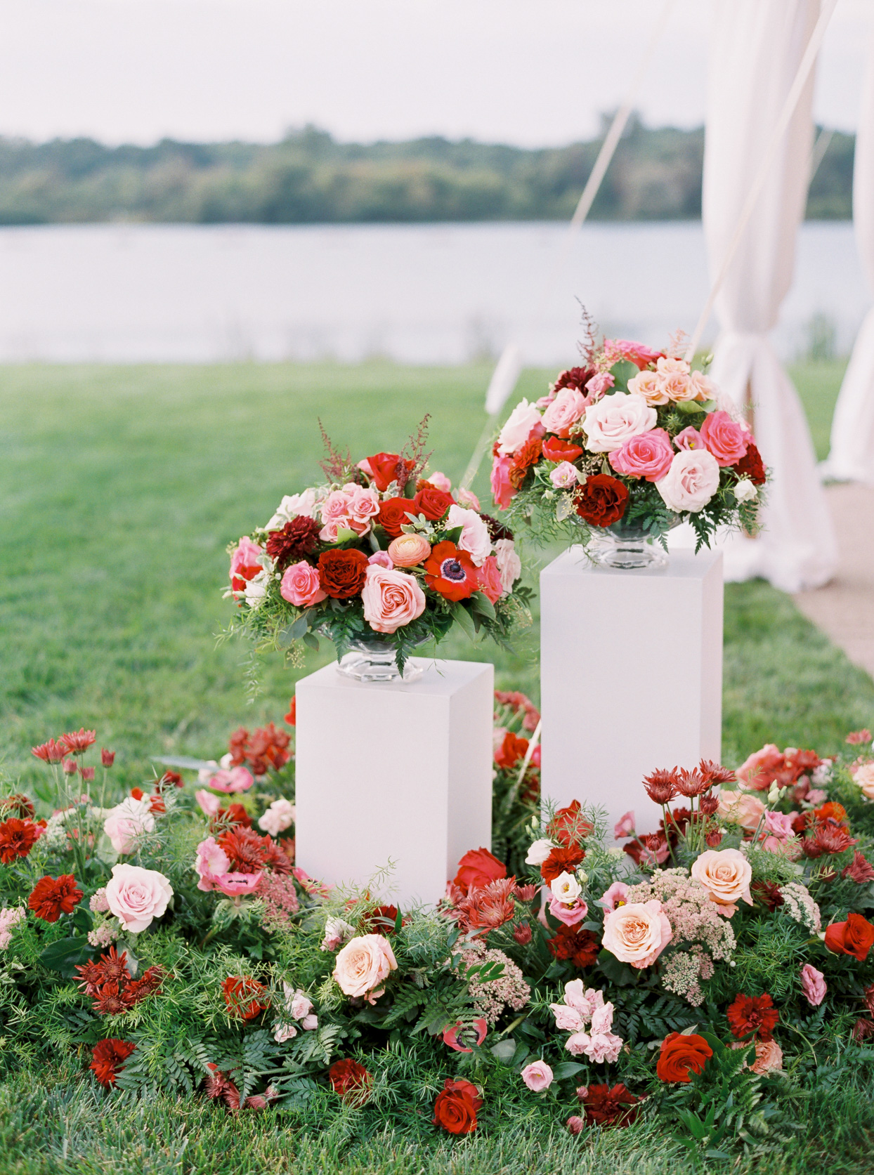 red and white flowers on pedestals