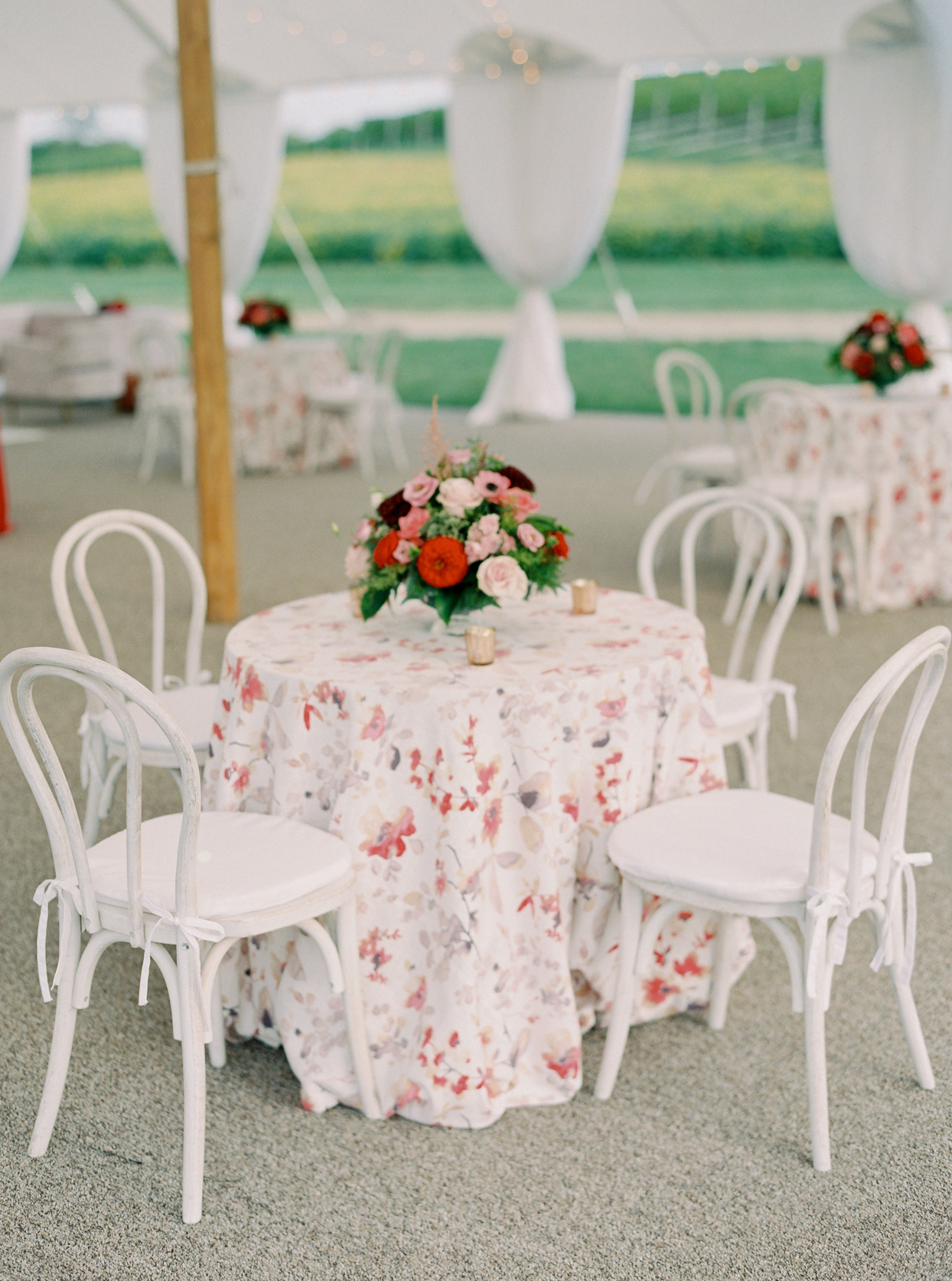 small wedding tables with floral tablecloths