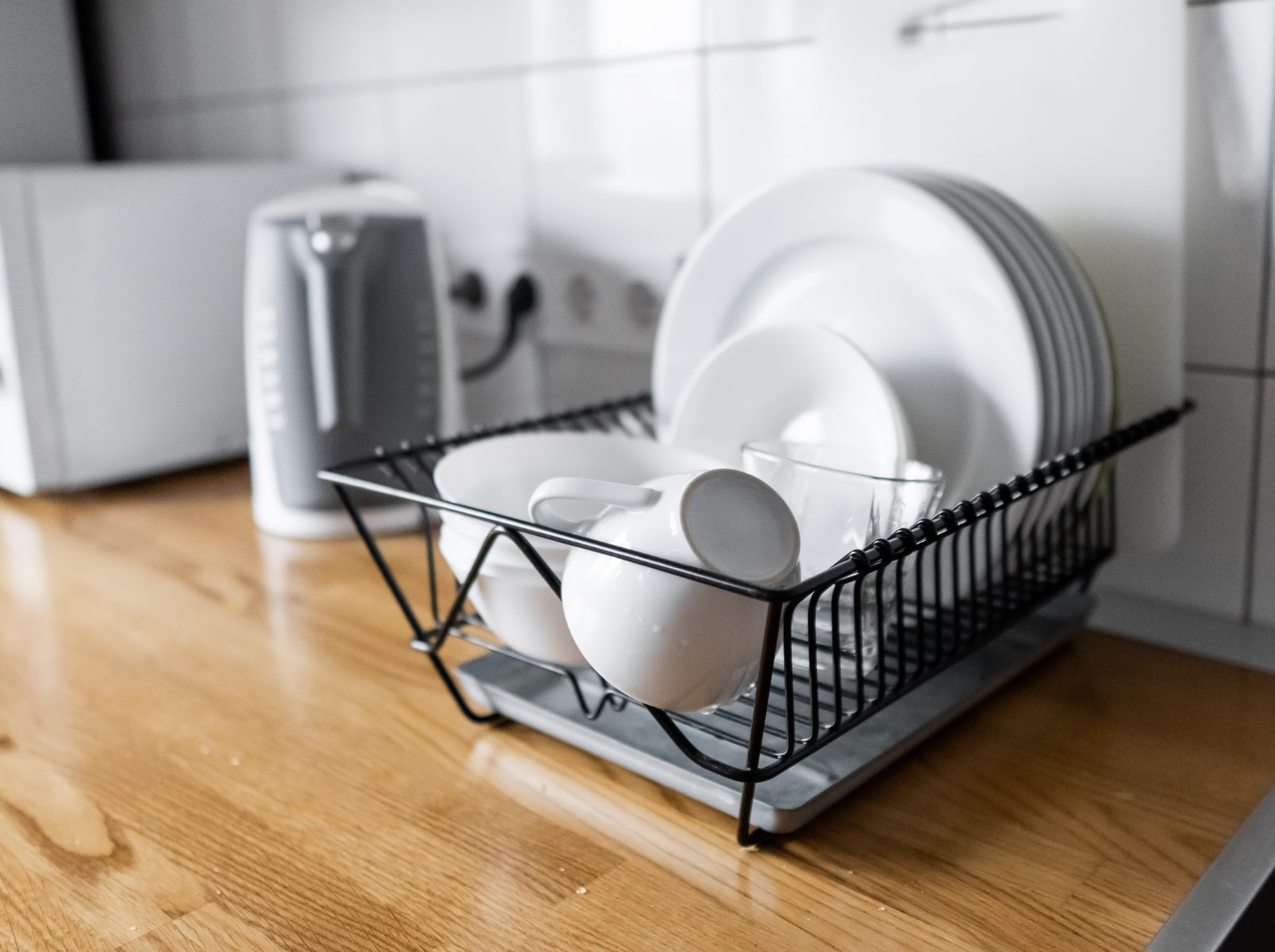 dishes drying on wire rack