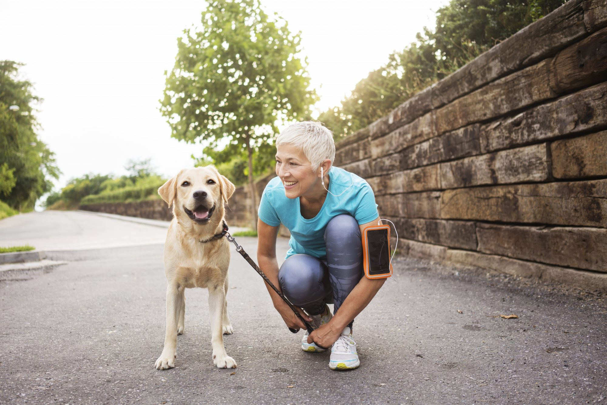 woman outside exercising with dog