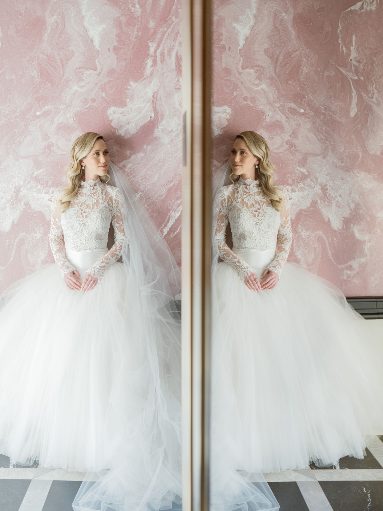 bride wearing high neck long sleeve gown looking in full length mirror