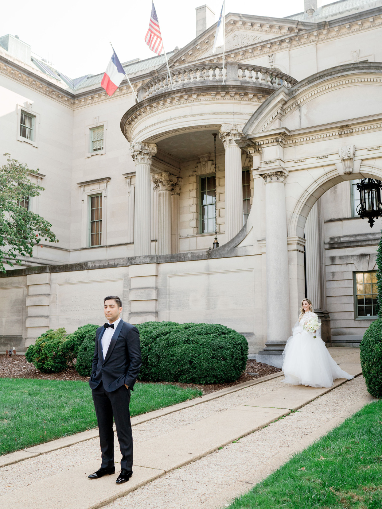 bride and groom sharing first look outside of venue