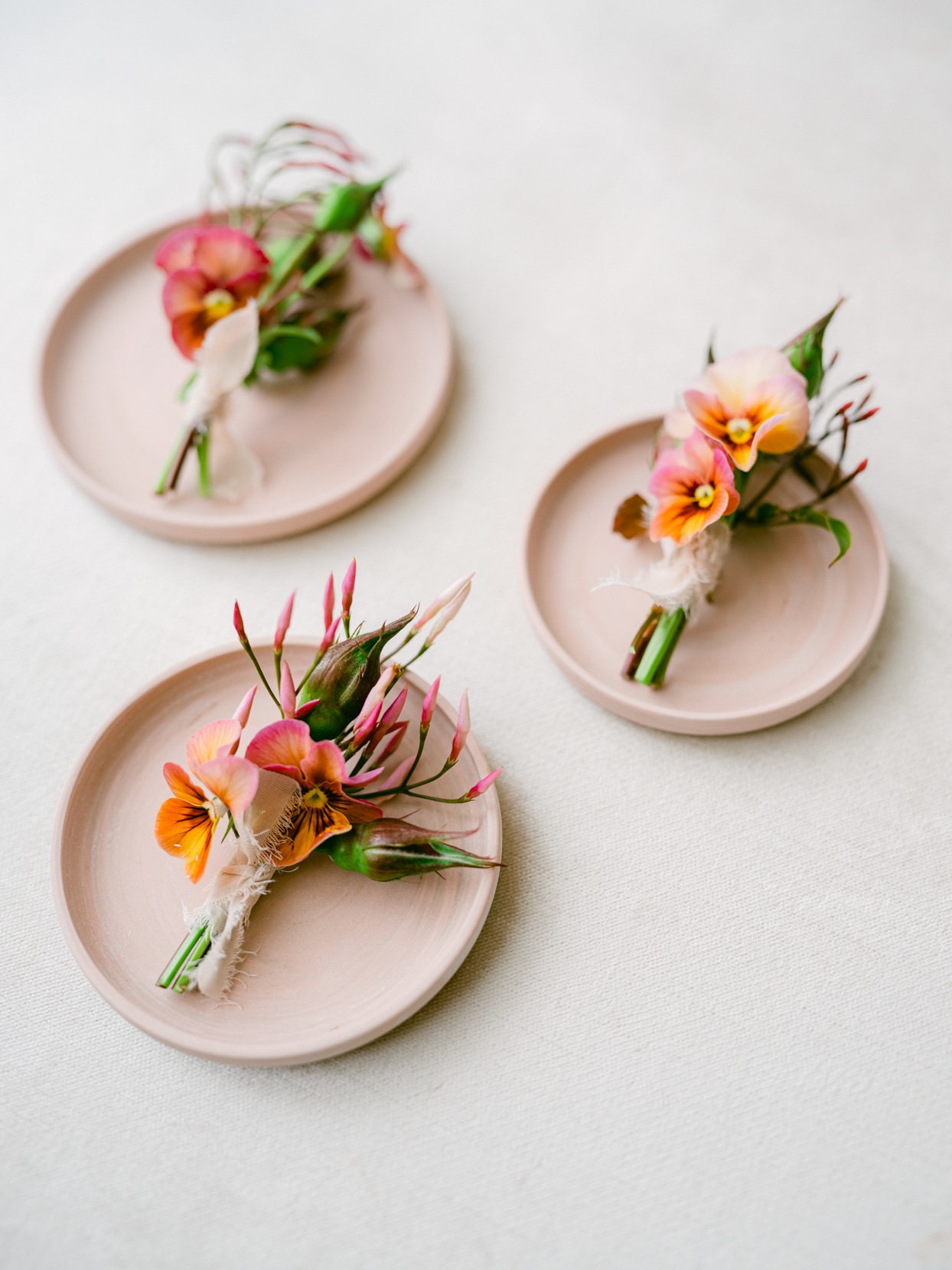 pink floral boutonnieres