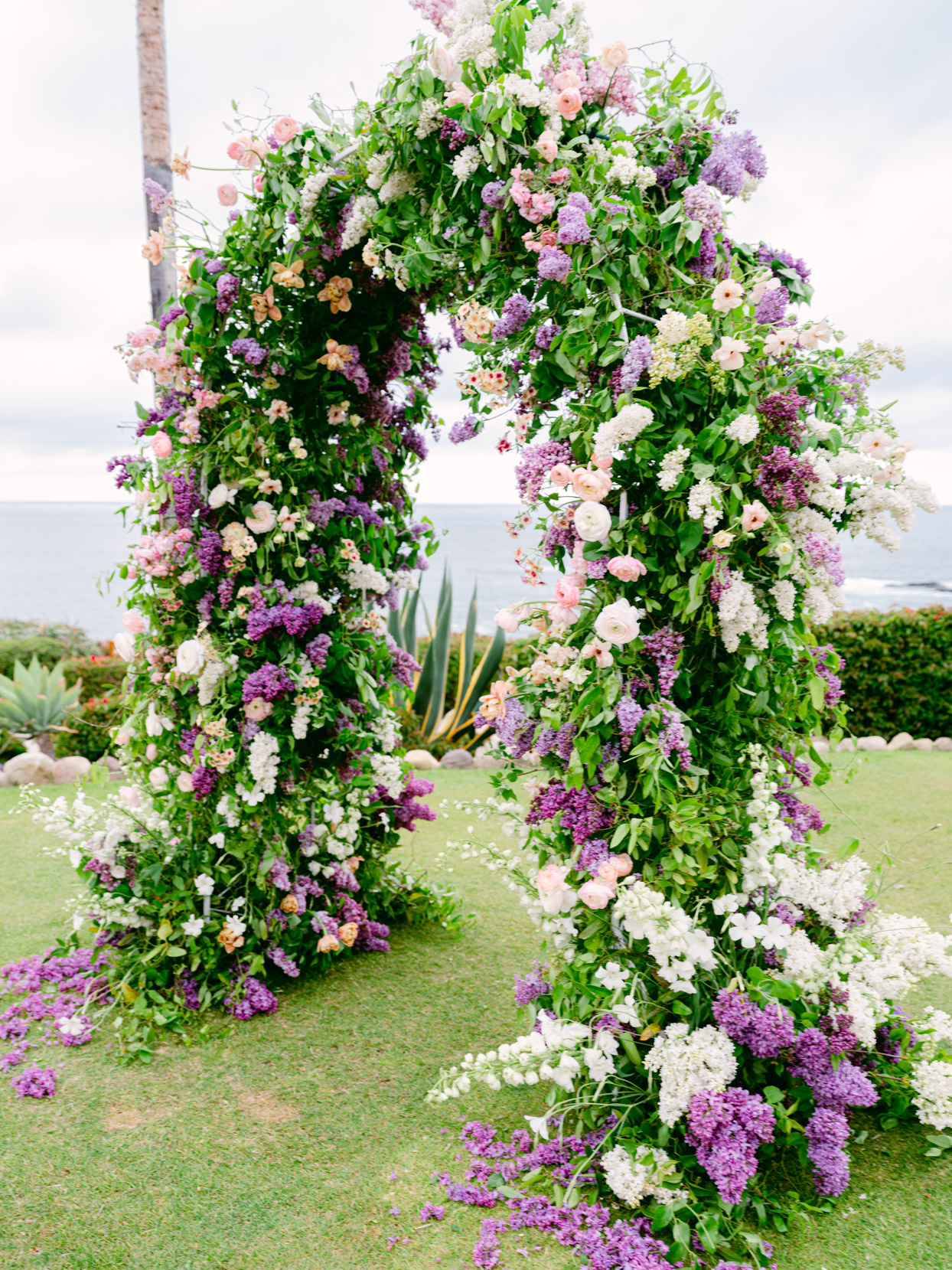 large purple and white floral wedding arch
