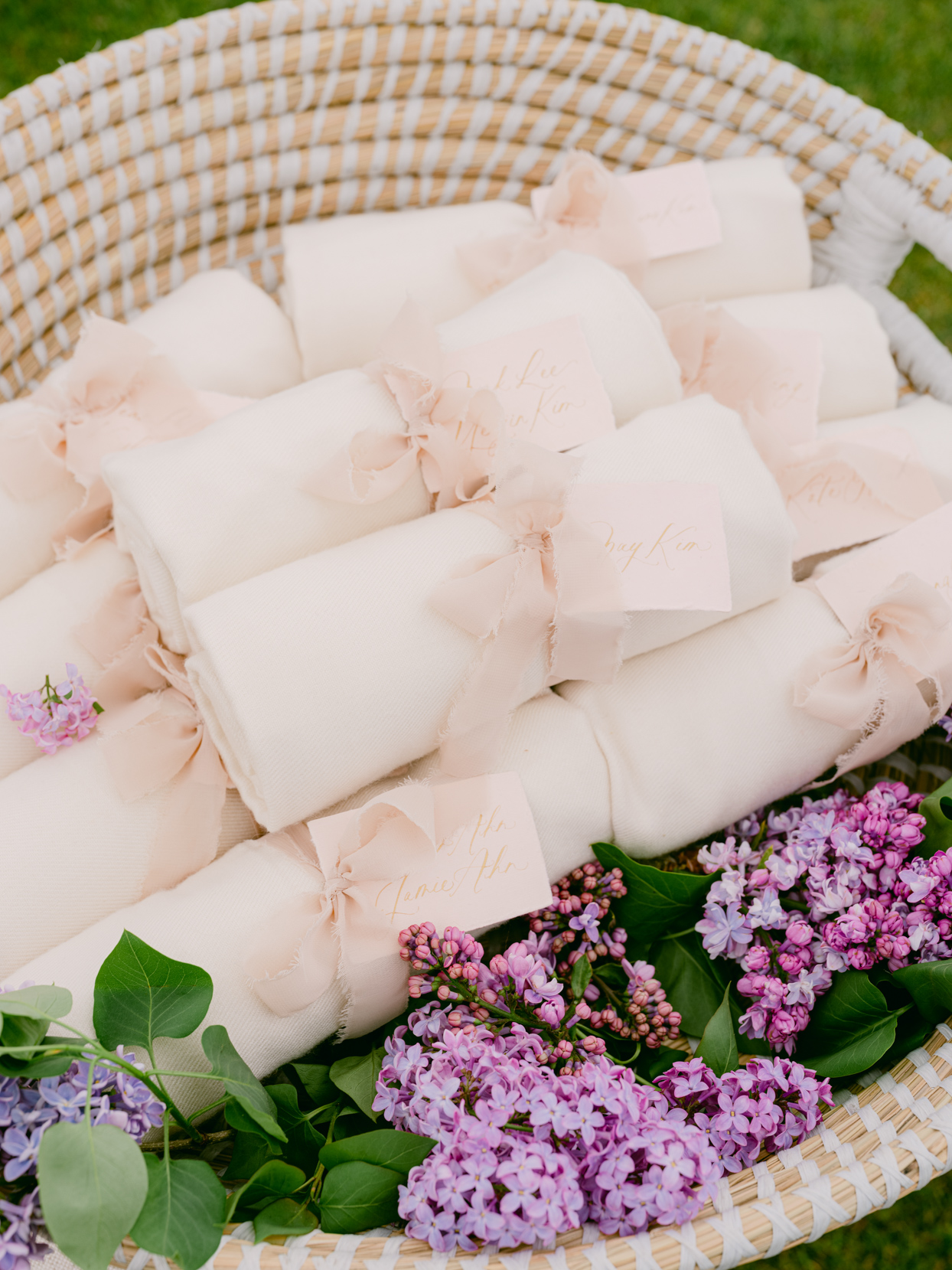 white linen wrapped pink bow tied wedding favors