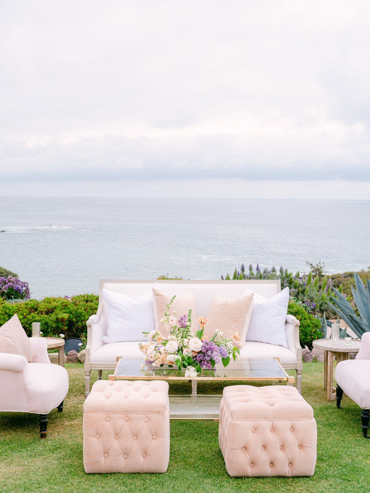 beige and white outdoor wedding lounge area