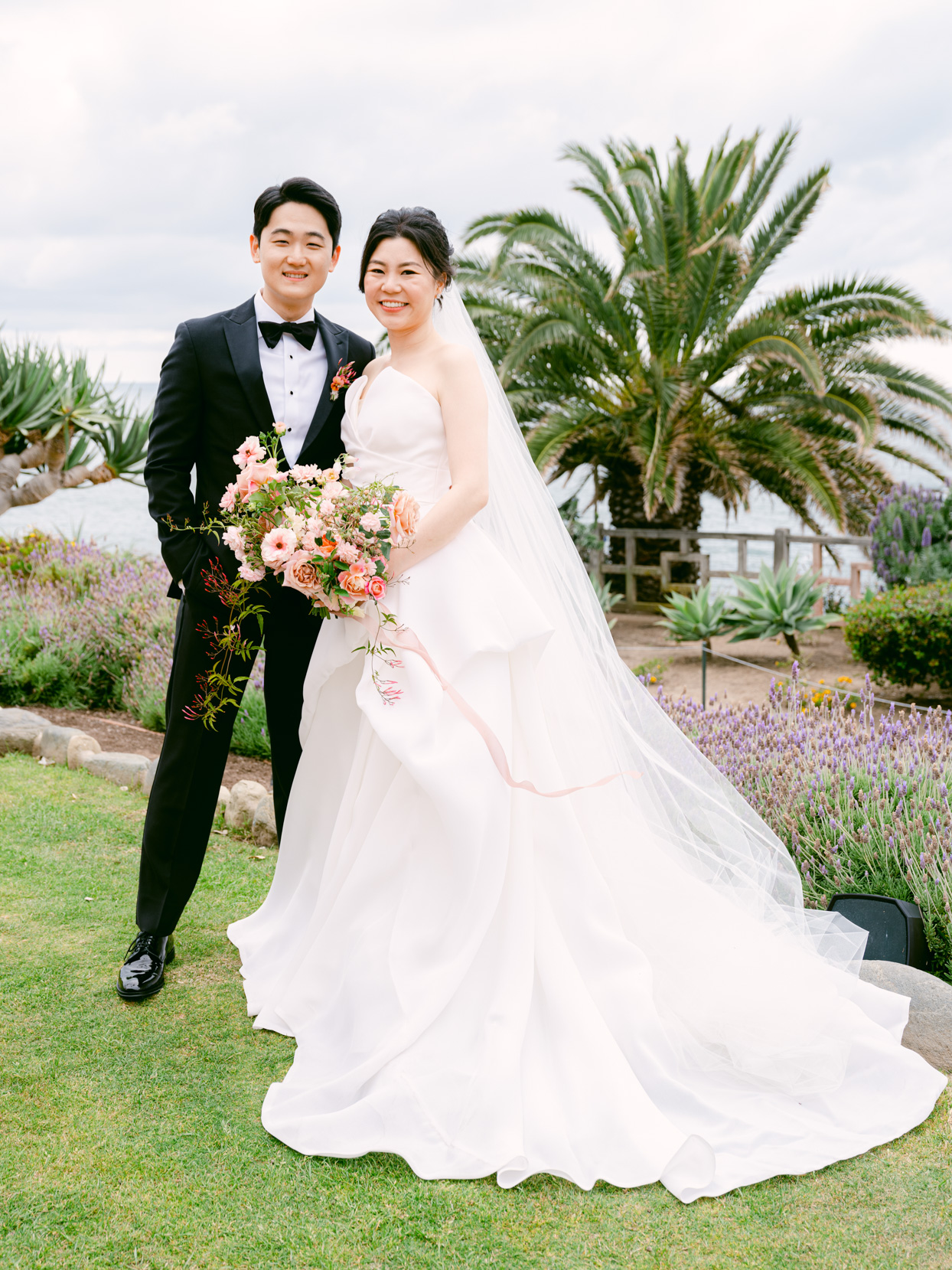 bride and groom smiling for outdoor wedding photos