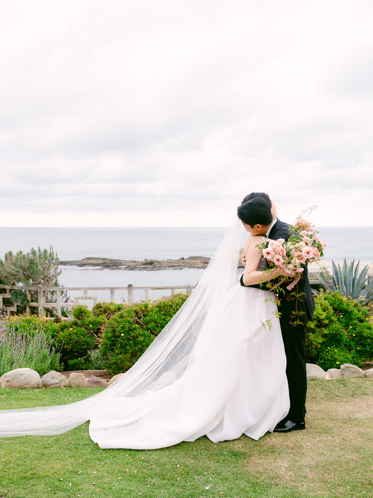 bride and groom hugging during first look