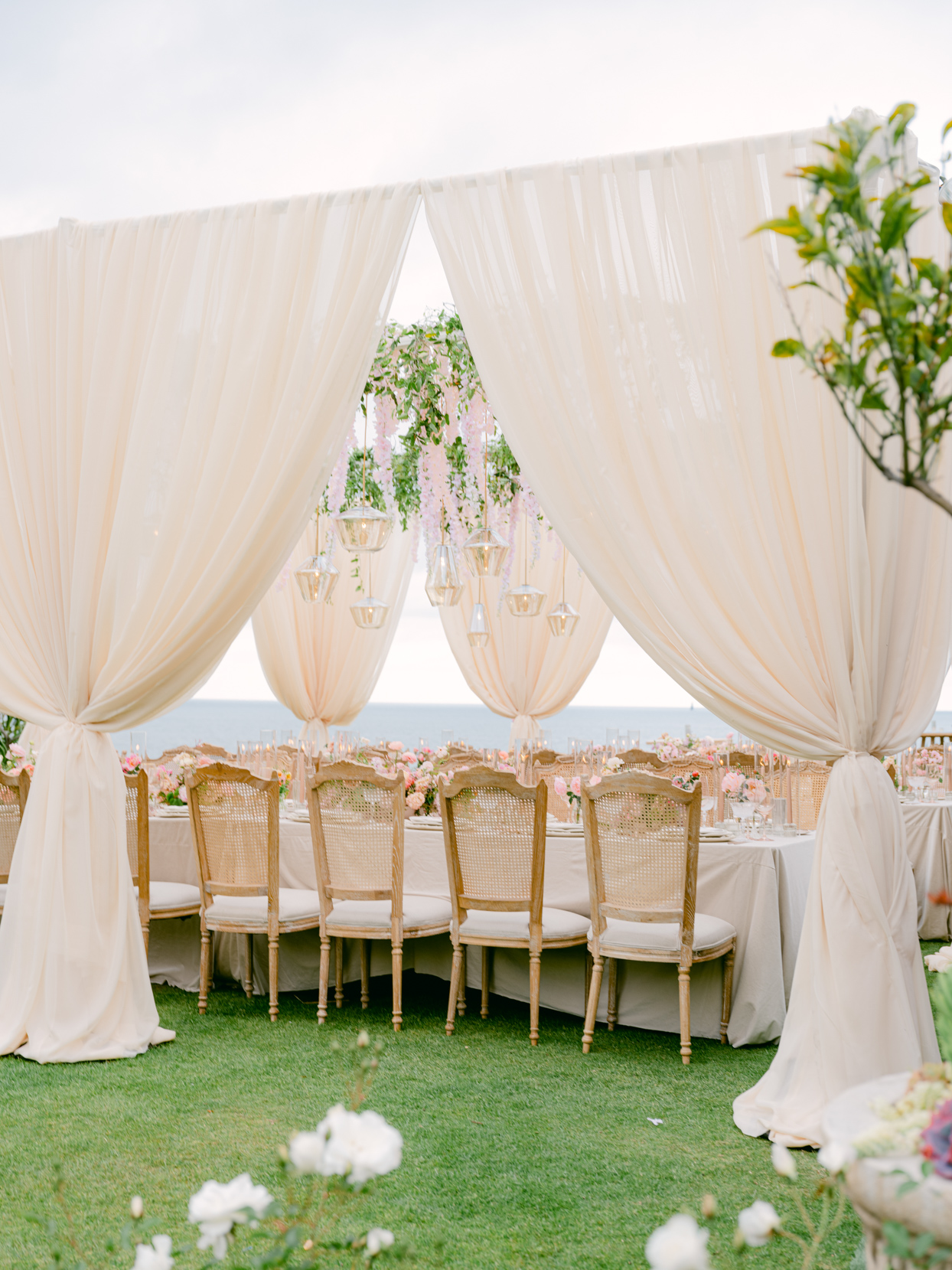 outdoor linen draped curtain reception seating area