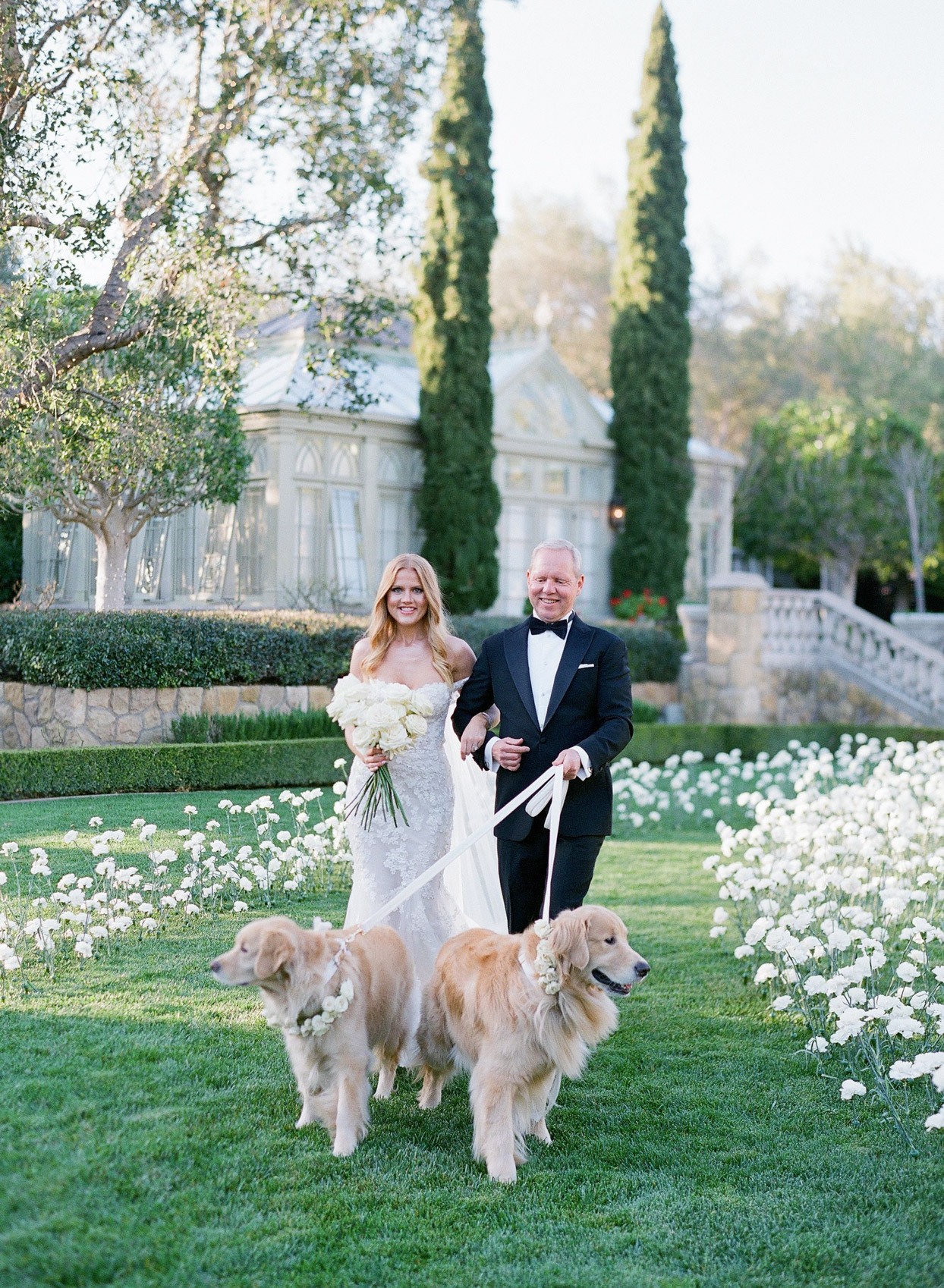 bride and father and two dogs processing at wedding