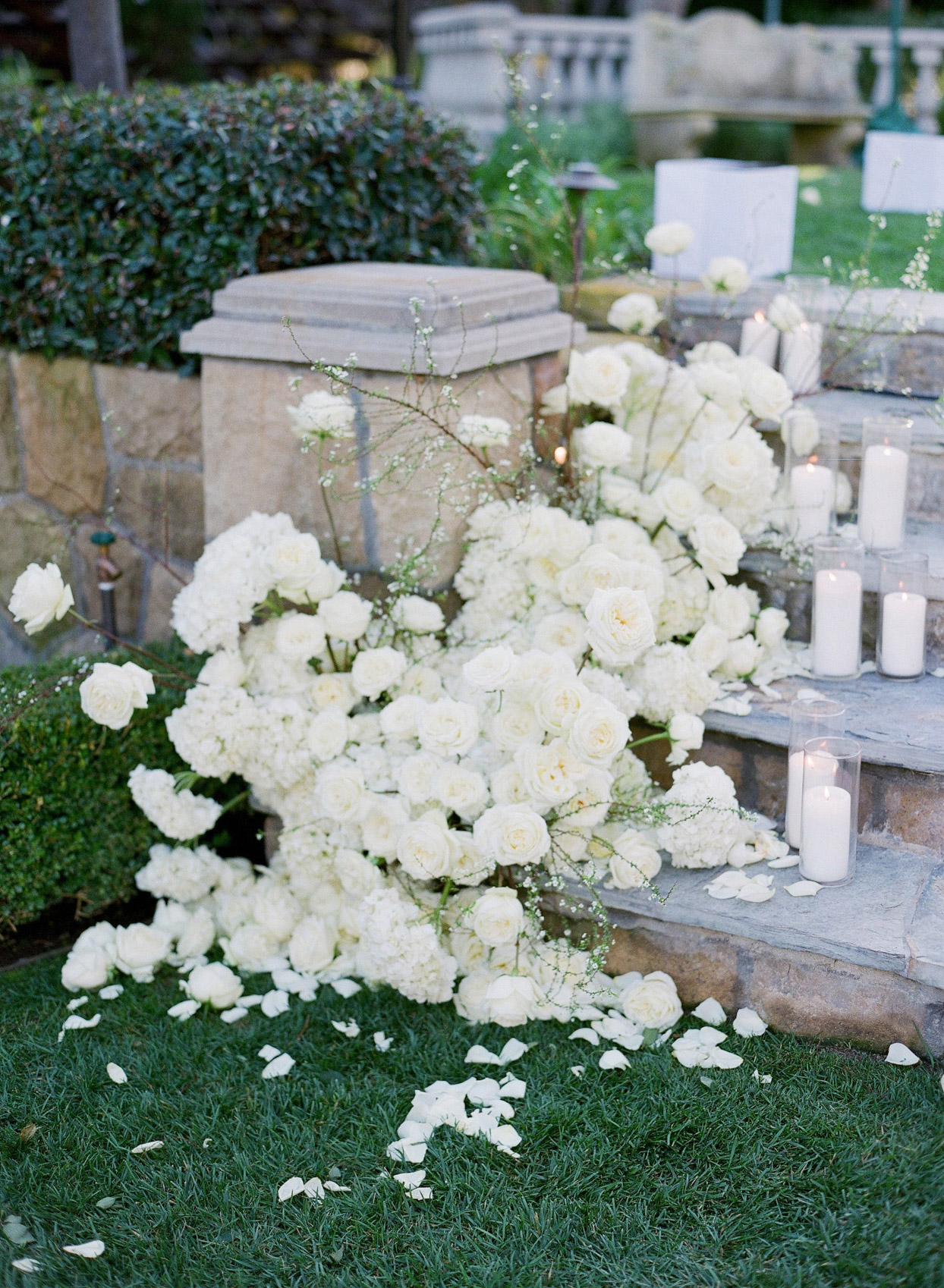 white roses and candles on wedding stairs
