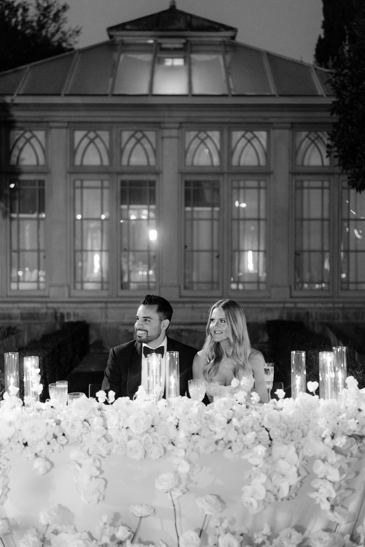 couple sitting at table for outdoor wedding dinner