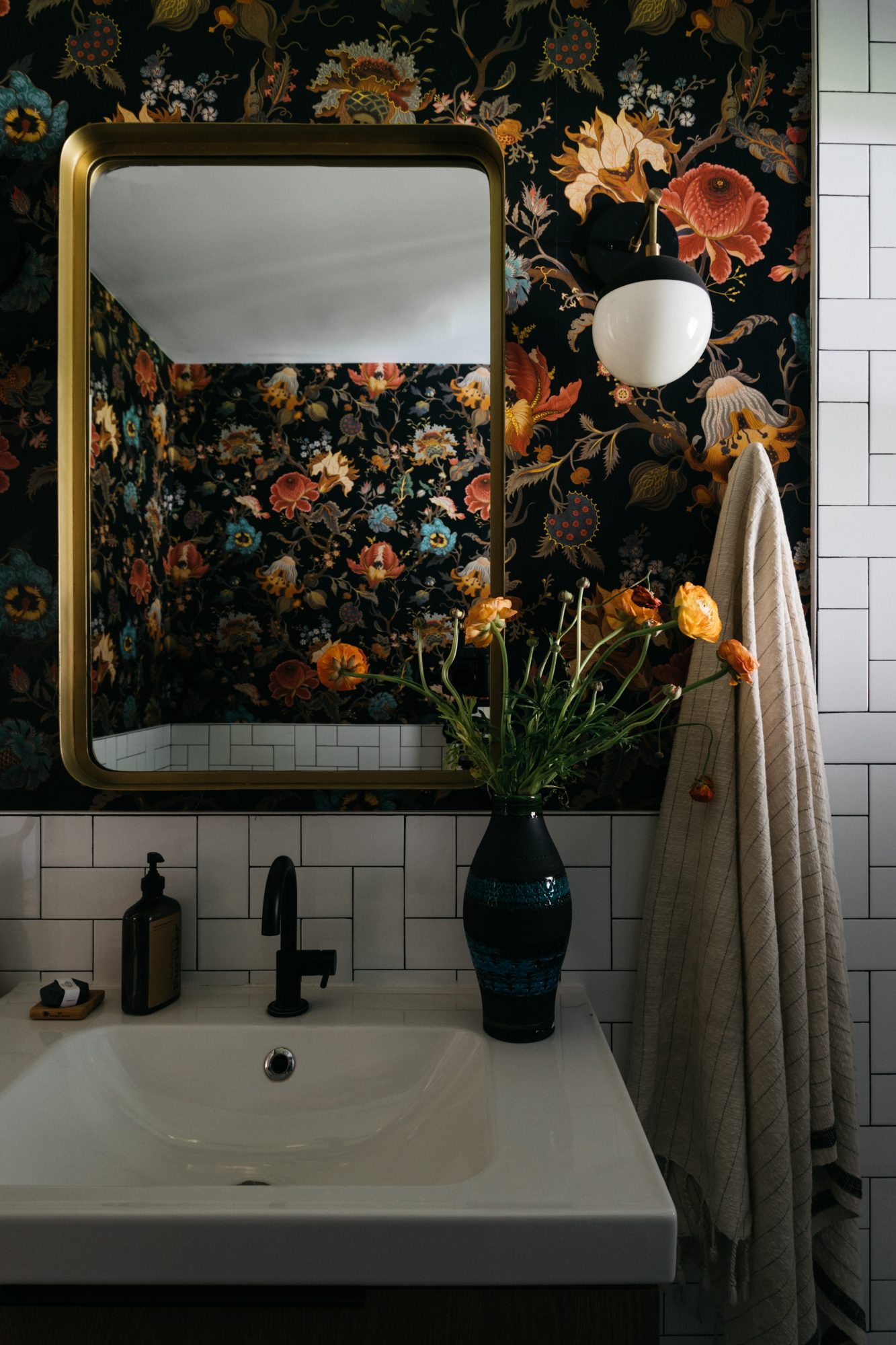 bathroom with floral wallpaper