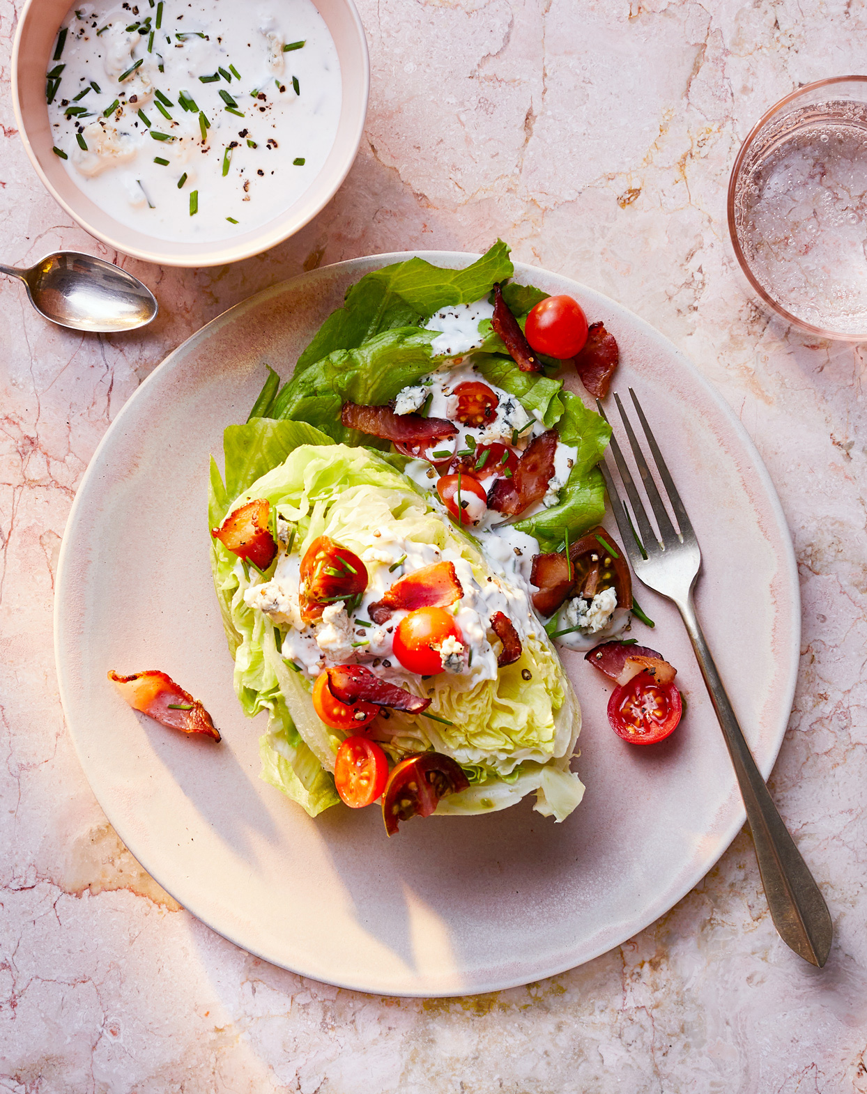 wedge salad served with buttermilk-blue-cheese dressing
