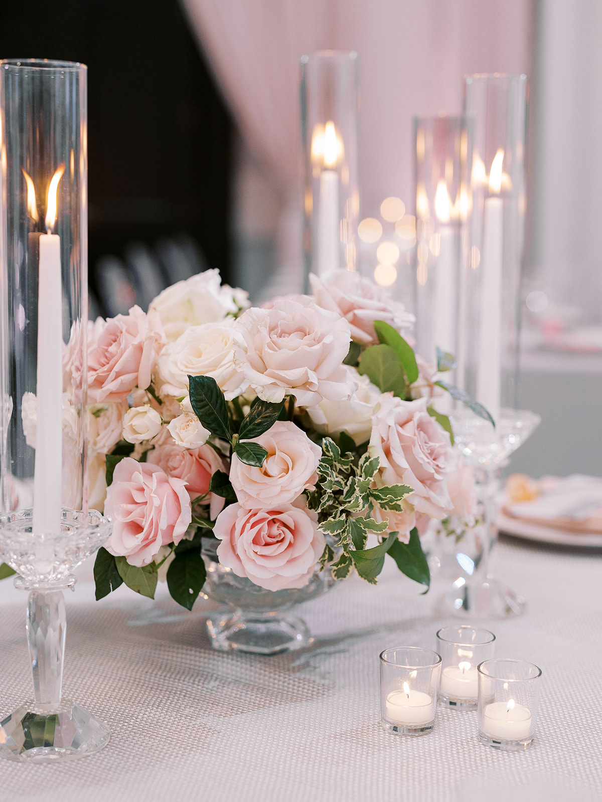 white and pink rose centerpieces at wedding