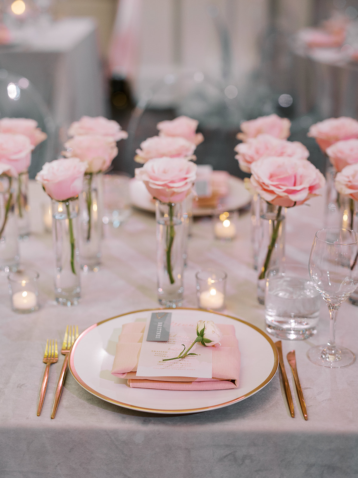place settings with pink roses