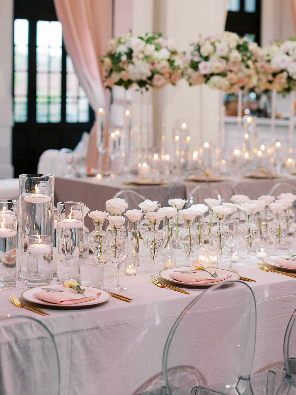 white flowers on reception tables at wedding