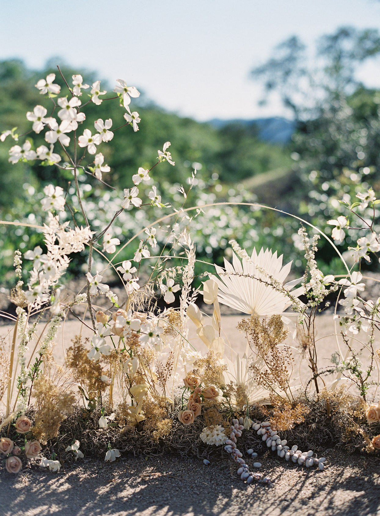 white and brown flower arch