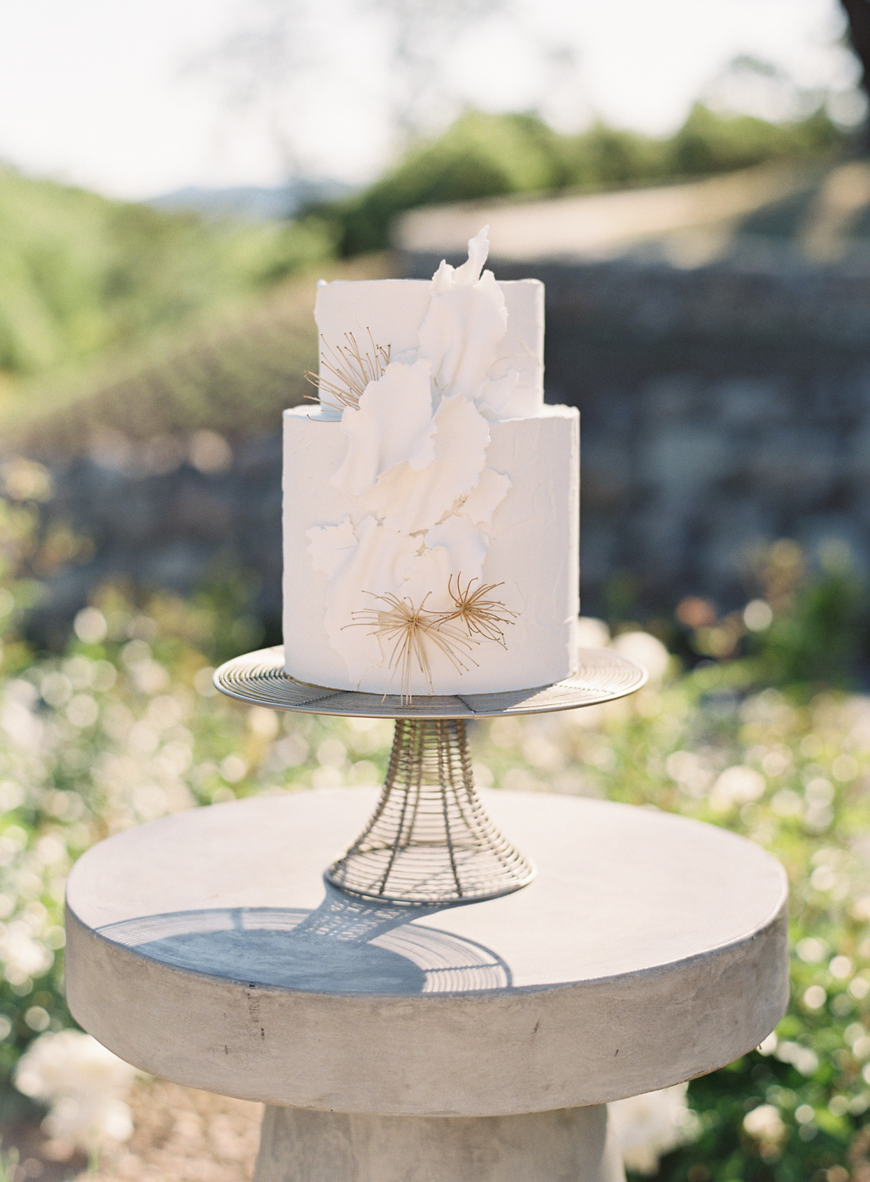 simple white two tear vow renewal cake on stone slab
