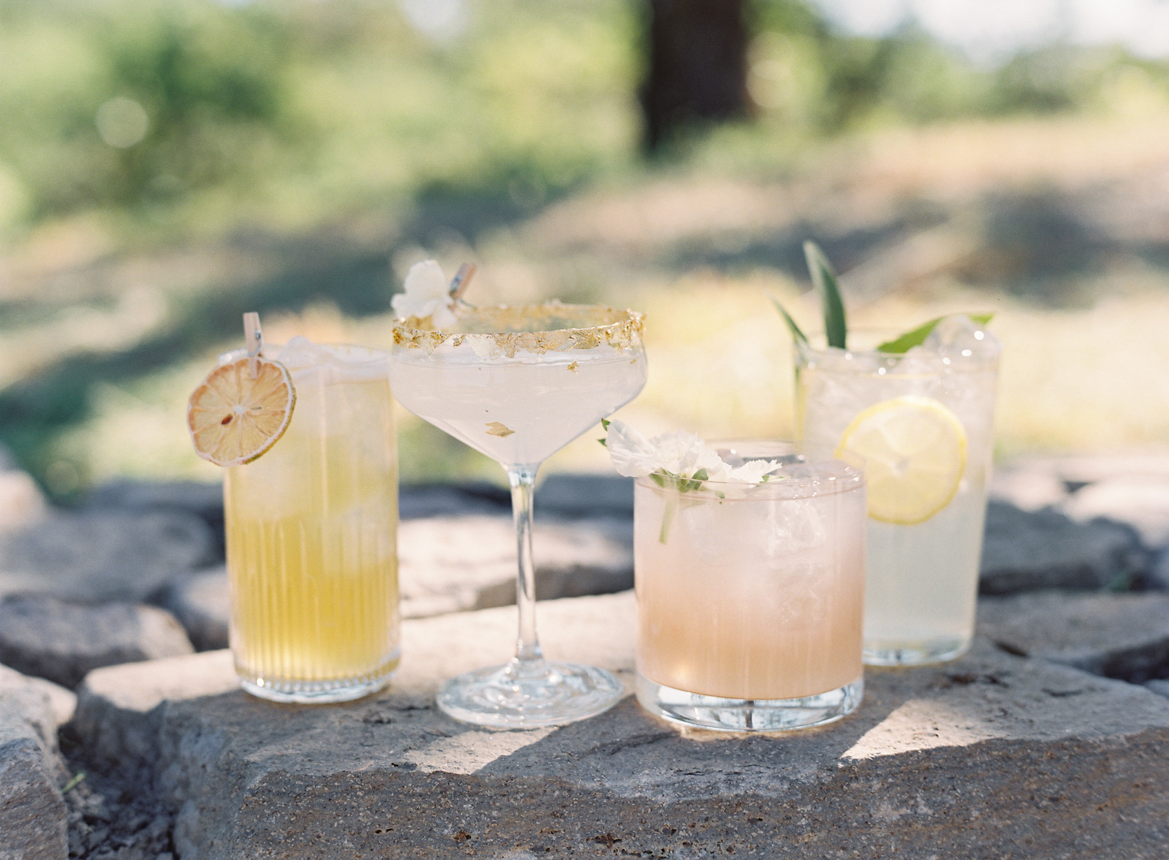 cocktails sitting on stones outdoors
