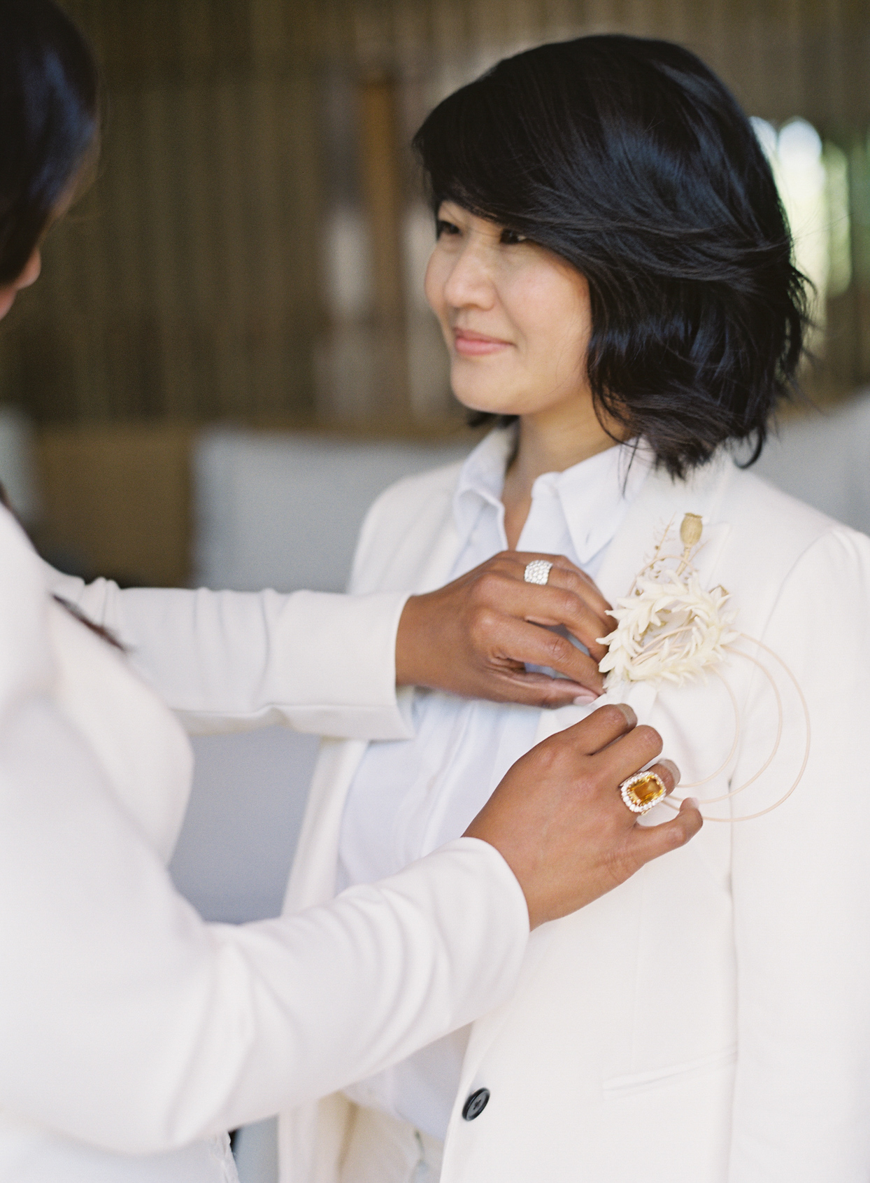 gloria putting on flower for vow renewal