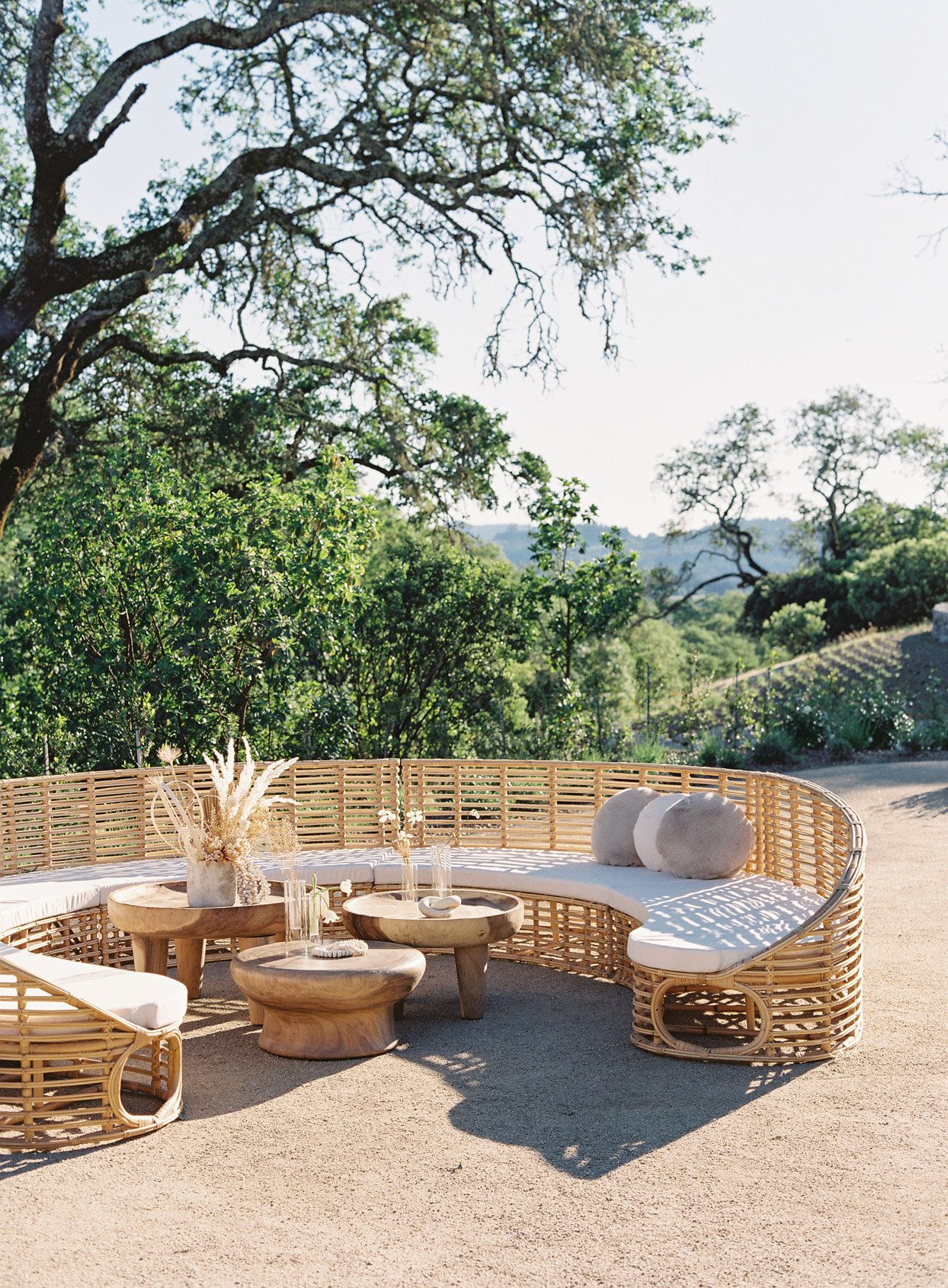 large circular wicker lounge for outdoor vow renewal