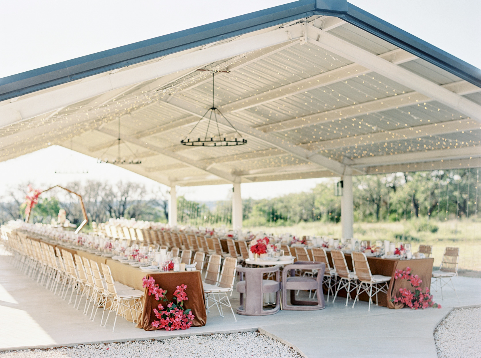 outdoor reception seating with long banquet tables