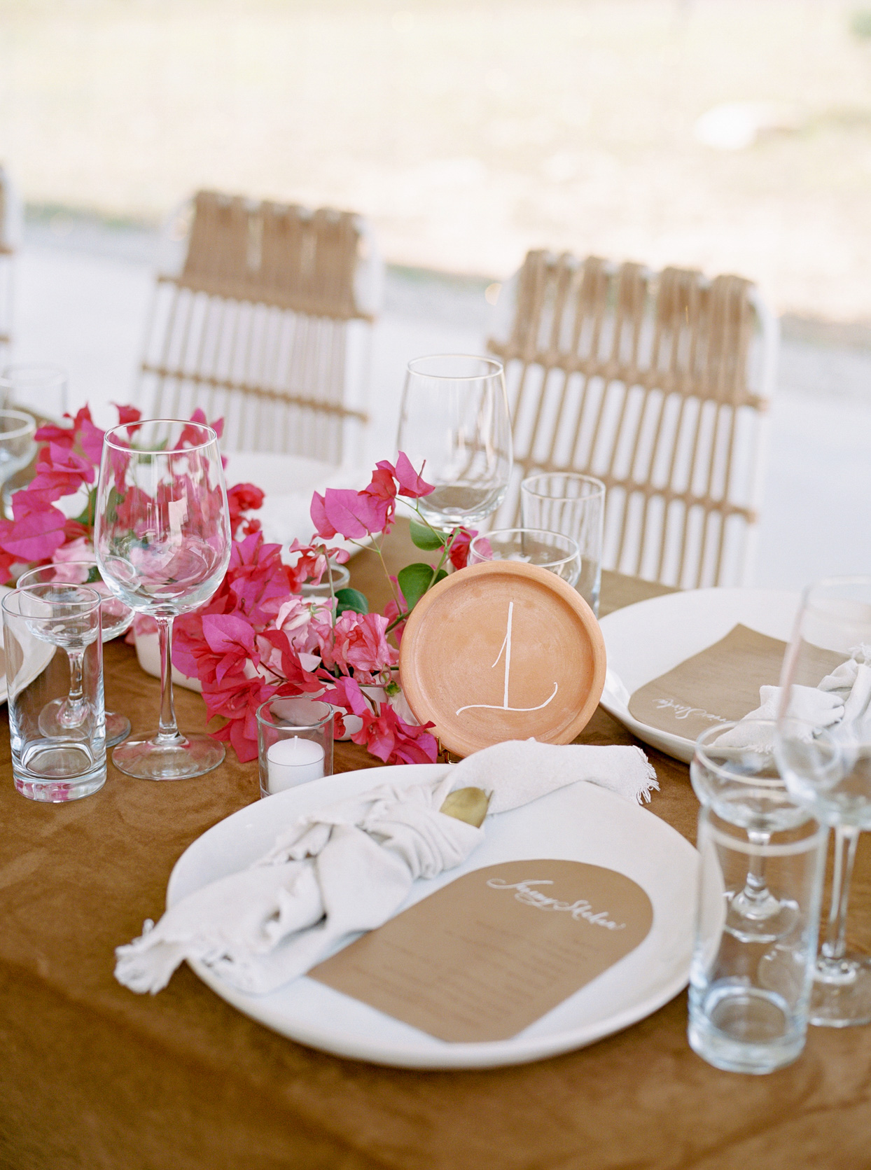 reception table with table numbers and place settings